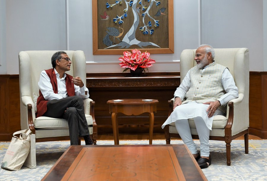Indian PM Narendra Modi (right) meeting with Nobel Laureate Abhijit Banerjee at 7, Lok Kalyan Marg. Photo courtesy: Twitter/@narendramodi