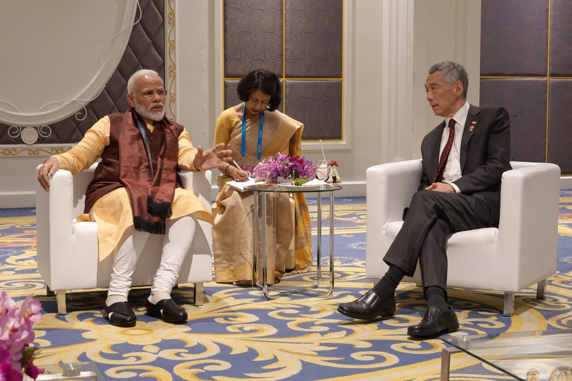 Prime Minister Lee Hsien Loong caught up with India PM Narendra Modi while waiting for the gala dinner at the ASEAN summit to begin. Photo courtesy: PMO