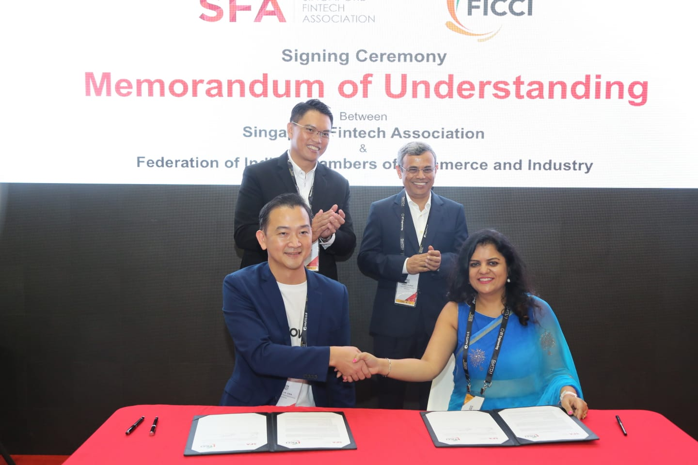 HE Jawed Ashraf, India's High Commissioner to Singapore (2nd row, right) and Patrick Tay, Assistant Secretary General, NTUC and MP, West Coast GRC (2nd row, left) witnessing the MoU signing ceremony between SFA and FICCI at the 4th Singapore FinTech Festival 2019. Navita Myer, Director, FICCI Singapore (1st row, right) and Chia Hock Lai, president, SFA signed the MoUs on behalf of their organisations