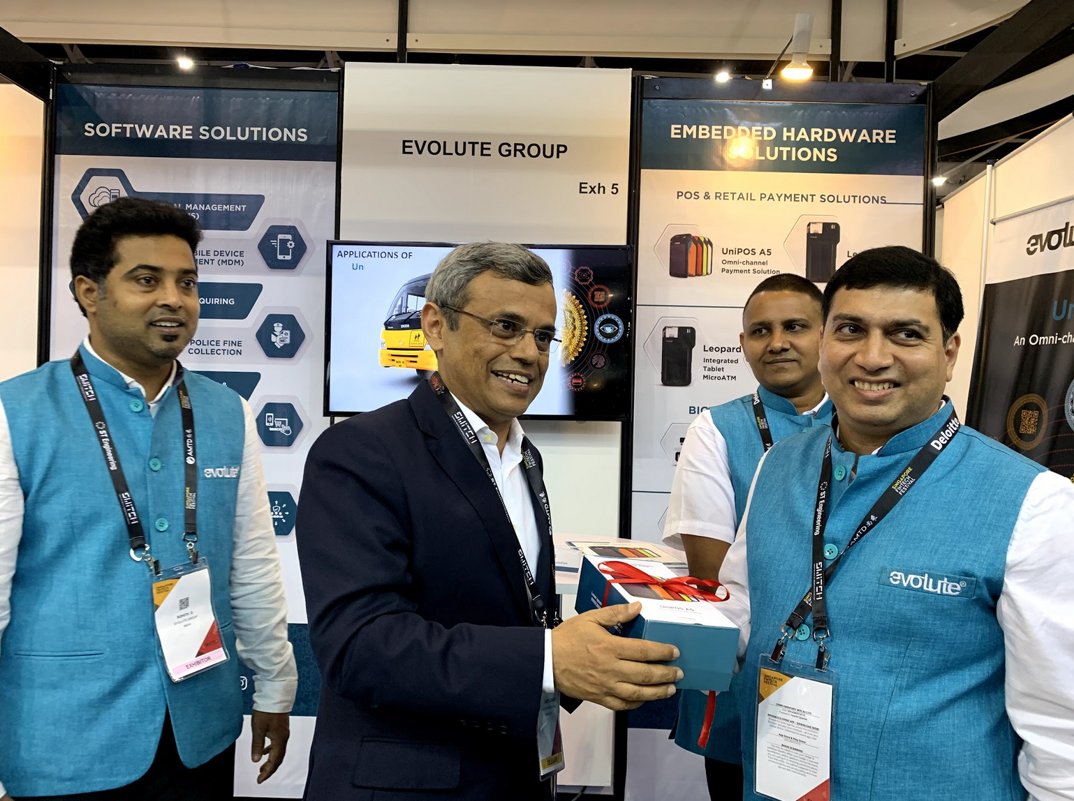 HCI Jawed Ashraf makes a point with an Evolute Point of Sales (POS) device. To his left is Parag Mehta, Founder and CEO, Evolute Group Photo: Connected to India