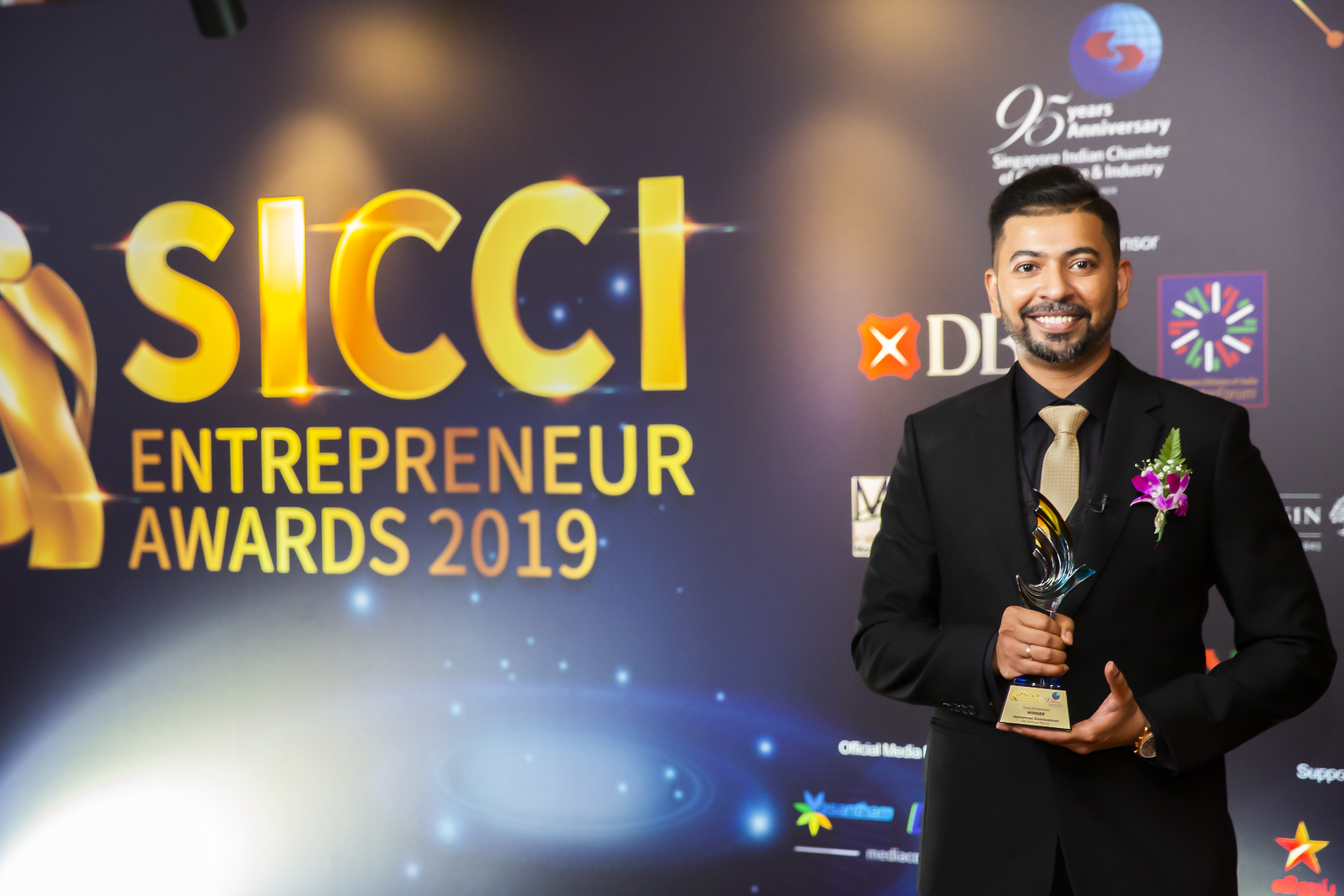 Jayavarman Gnanansekaran, CEO Dei Holding Pte Ltd poses with the  Young Entrepreneur Award at the 2019 SICCI Awards ceremony at MBS Singapore. Photo Courtesy: SICCI