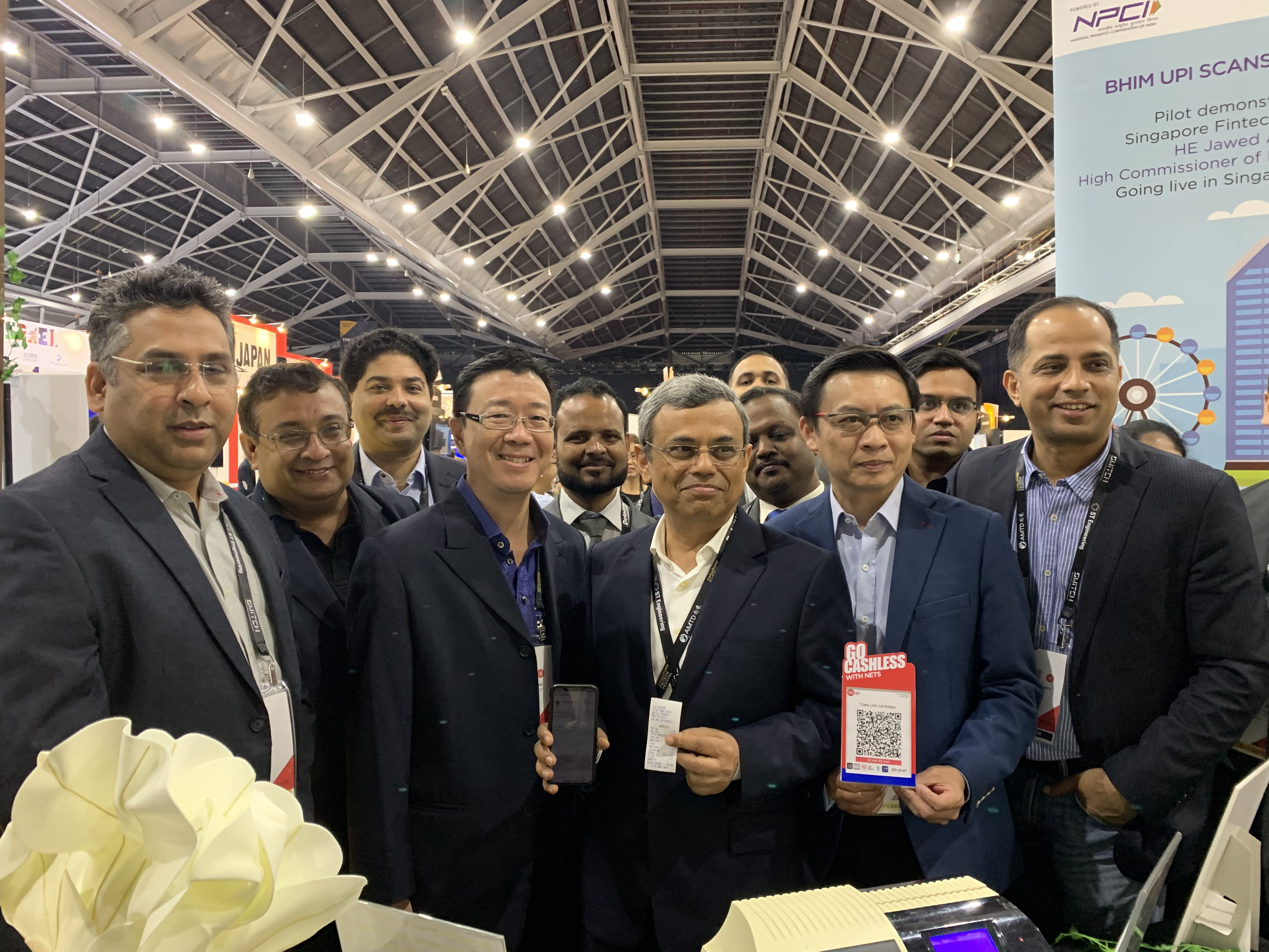 H.E. Jawed Ashraf, High Commissioner of India to Singapore holding the receipt and the phone used to pay for coffee using QR based payment system BHIM at Singapore Fintech Festival 2019. Photo courtesy: Connected to India