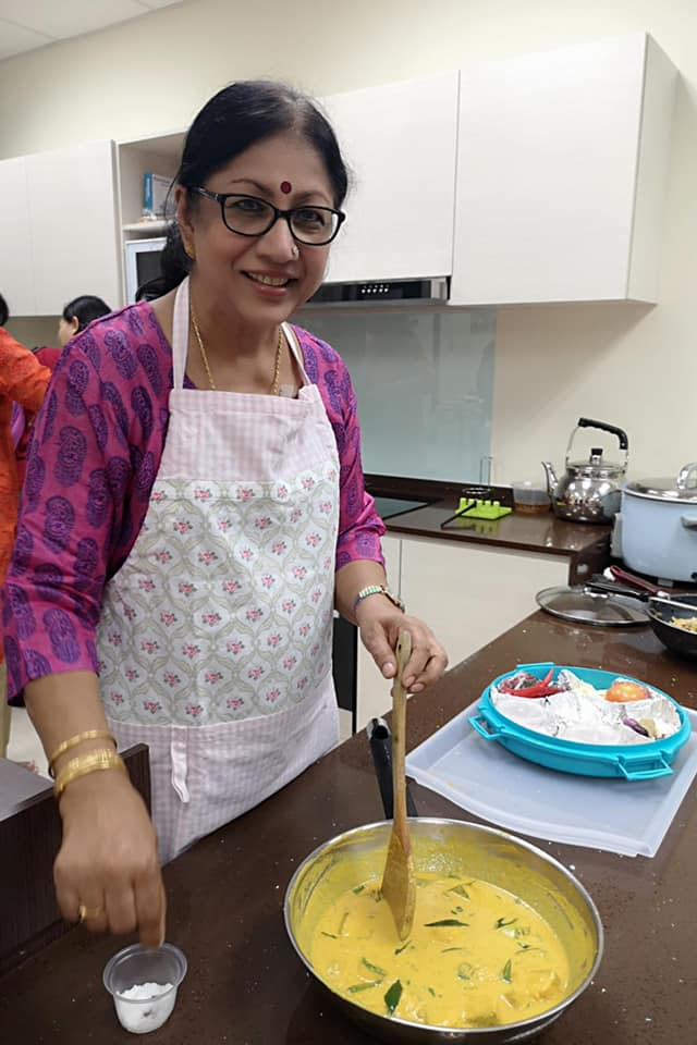 The tangy fish curry, with generous servings of salmon, by one of the special guest chefs, Mrs Jalaja Pillay,  left everyone yearning for more at the special demonstration of Malayalee cooking. Photo Credit: SMA Youth Wing