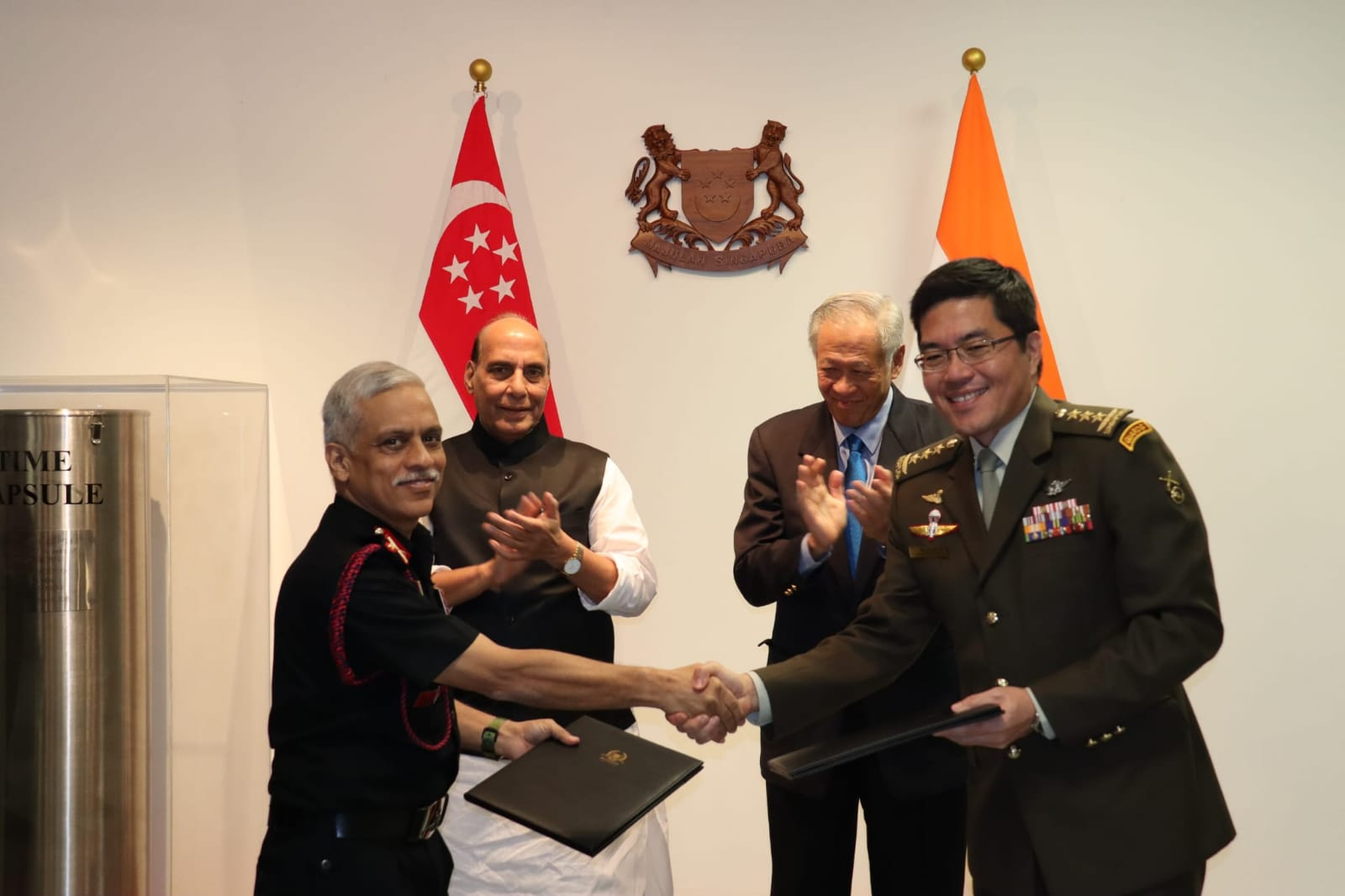 Defence Ministers of India (left) and Singapore applaud in the background at the conclusion of the 4th