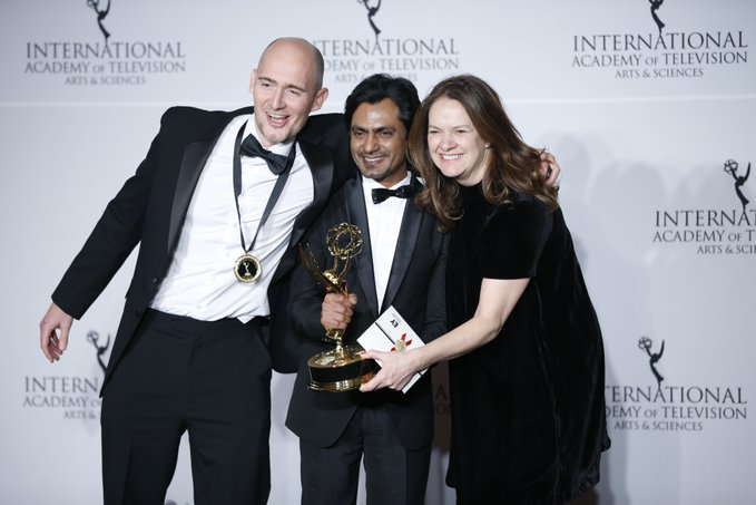 Nawazuddin Siddiqui (centre), who played Indian businessman Dilly Mahmood in British crime drama television series 'McMafia' 'McMafia' which won the award for Best Drama Series at the International Emmys 2019, posing with co-stars James Watkins and Dixie Linder. Photo courtesy: Twitter/@iemmys