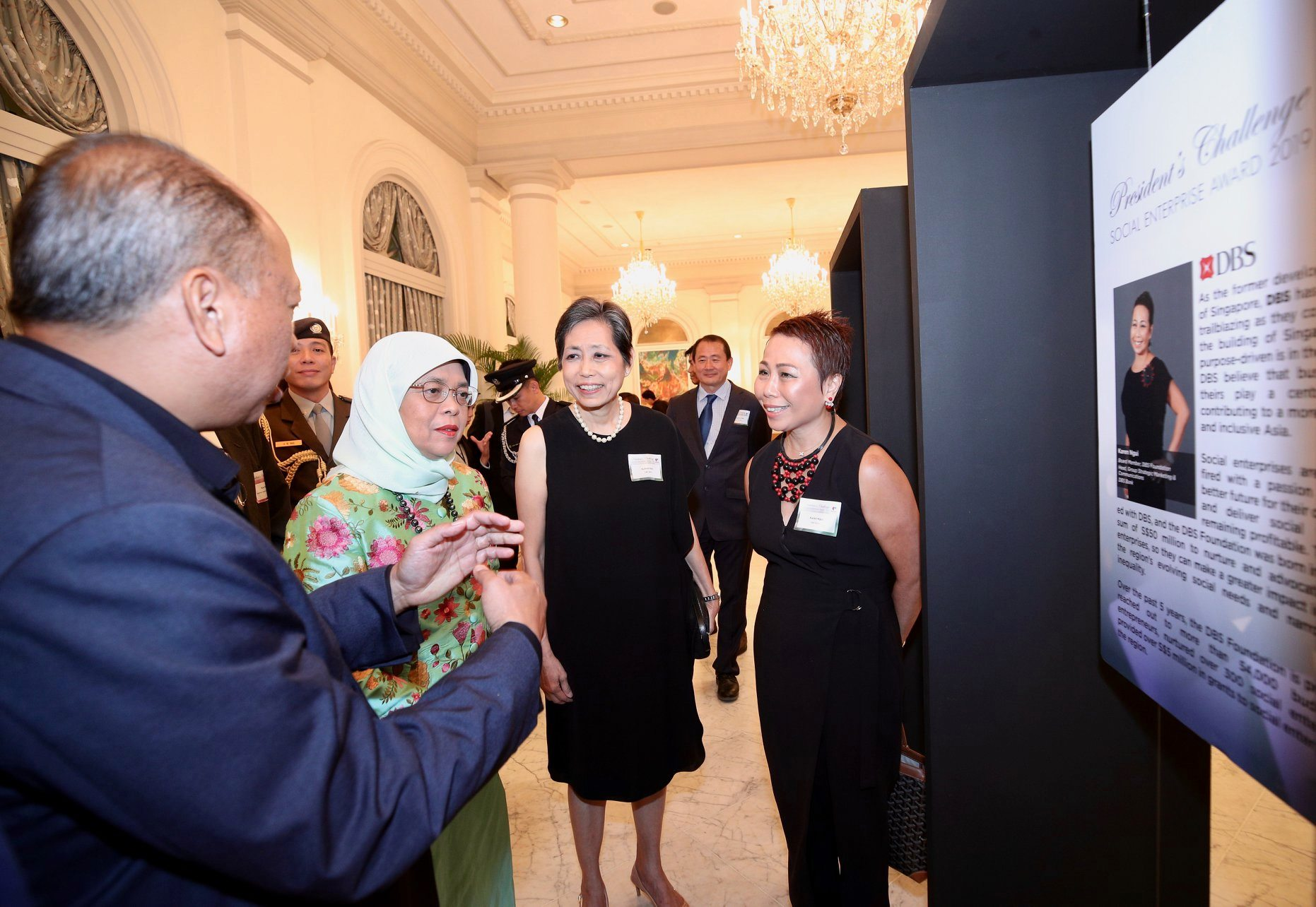 DBS shares with President Halimah how they had helped to nurture over 300 social enterprises through awareness building activities, funding support, capacity building initiatives, and access to lower banking fees. Photo courtesy: MCI, Chwee