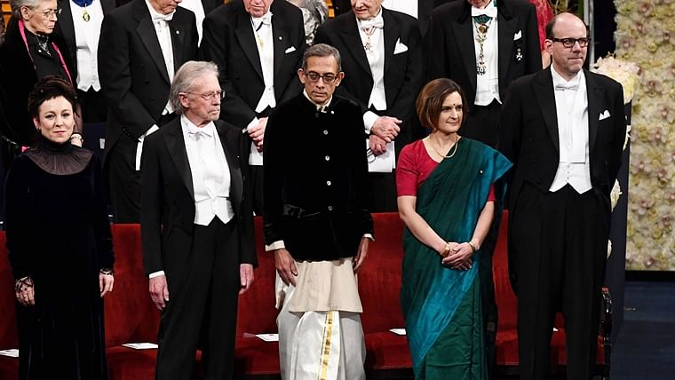 Dressed in Indian clothes, Abhijit Banerjee and Esther Duflo received their Nobel Prize in Economics in Stockholm on Tuesday. Photo courtesy: Twitter/@SwedeninMumbai