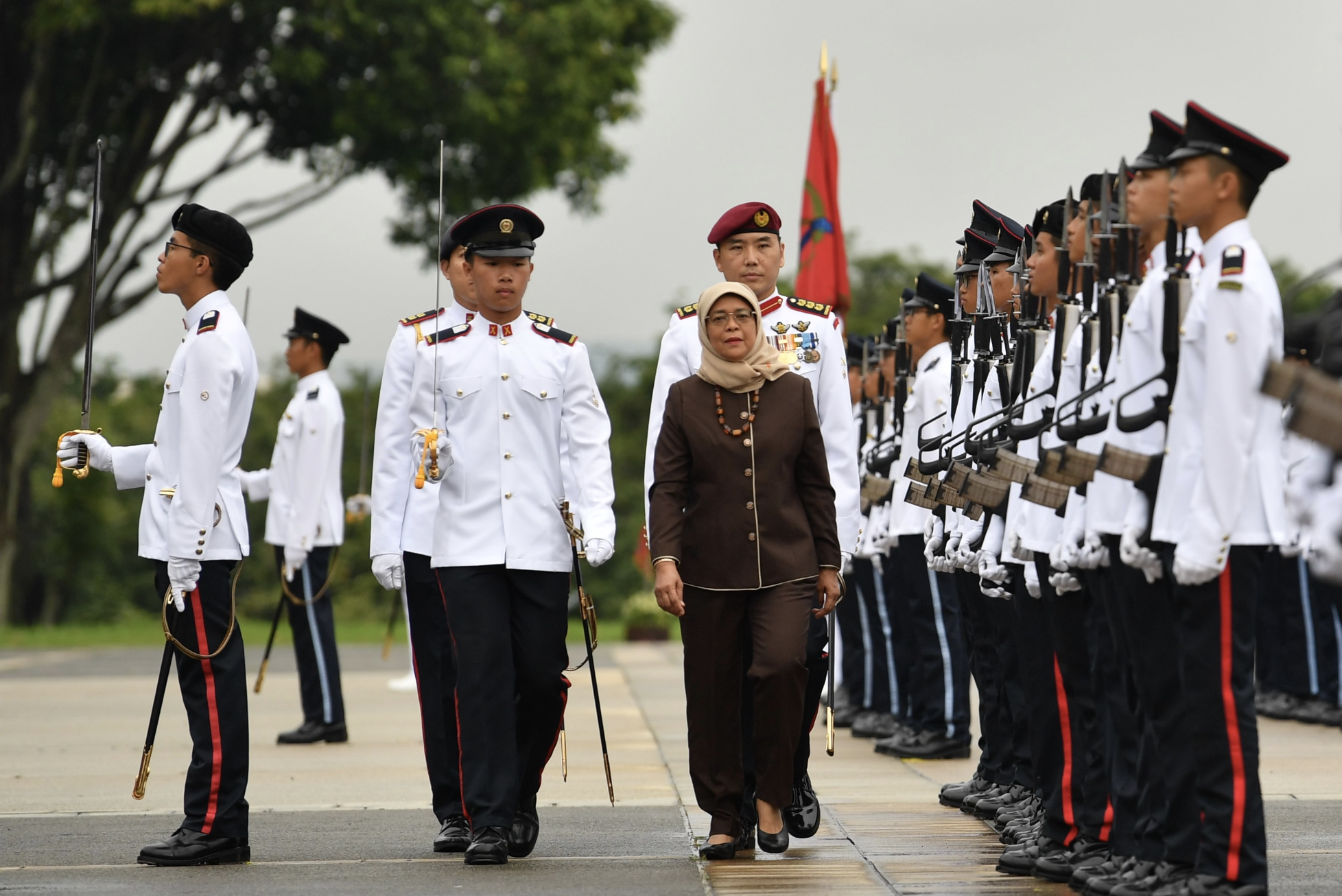 President Halimah Yacob reviewing the contingents at the 115/19 Officer Cadet Commissioning Parade (OCCP) held at SAFTI Military Institute (MI) on December 15. Photo courtesy: Mindef
