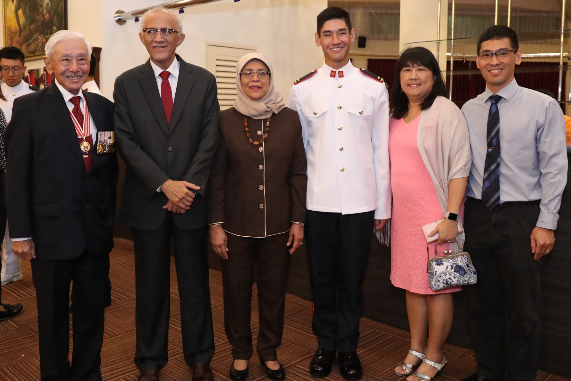President Halimah with General Winston Choo (first from left), Singapore's first Chief of Defence Force and his grandson, 2LT Daniel Choo (third from right) who was commissioned as SAF officer this evening. Photo courtesy: MCI, Clement