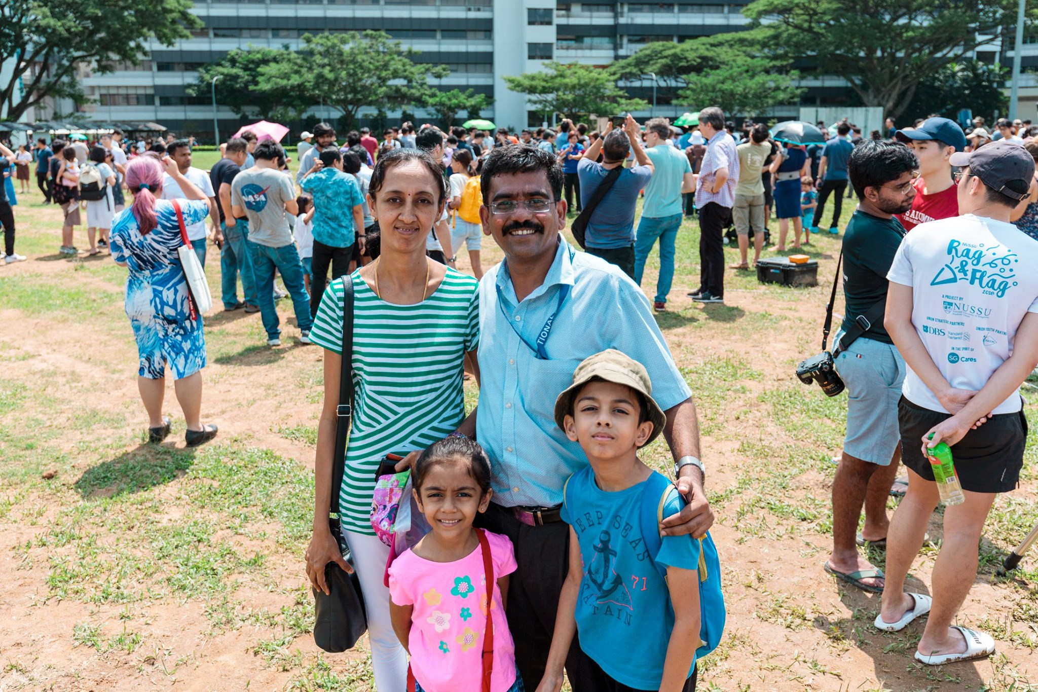 NUS Yong Loo Lin School of Medicine Asst Prof Karthik Mallilankarama and his family went down to the NUS Field to witness the eclipse. Photo courtesy: NUS
