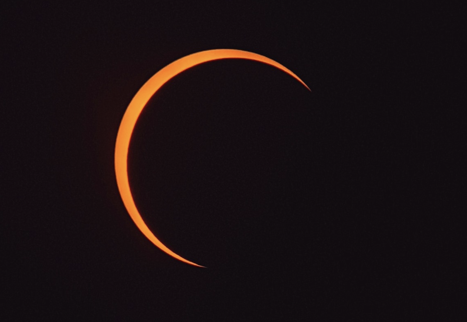 NUS Engineering undergrad and NUS Astronomical Society member Julian Cheung captured this image of the eclipse nearing its climax. Photo courtesy: Julian Cheung