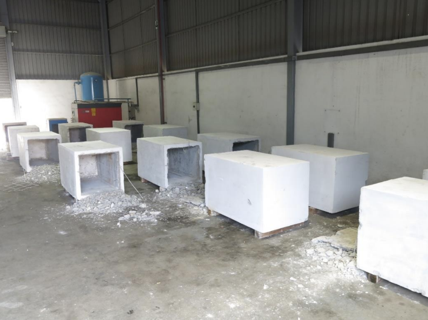14 concrete blocks which had concealed the duty-unpaid cigarettes were found during the follow-up search at an industrial unit in Gul Road. Photo courtesy: Singapore Customs