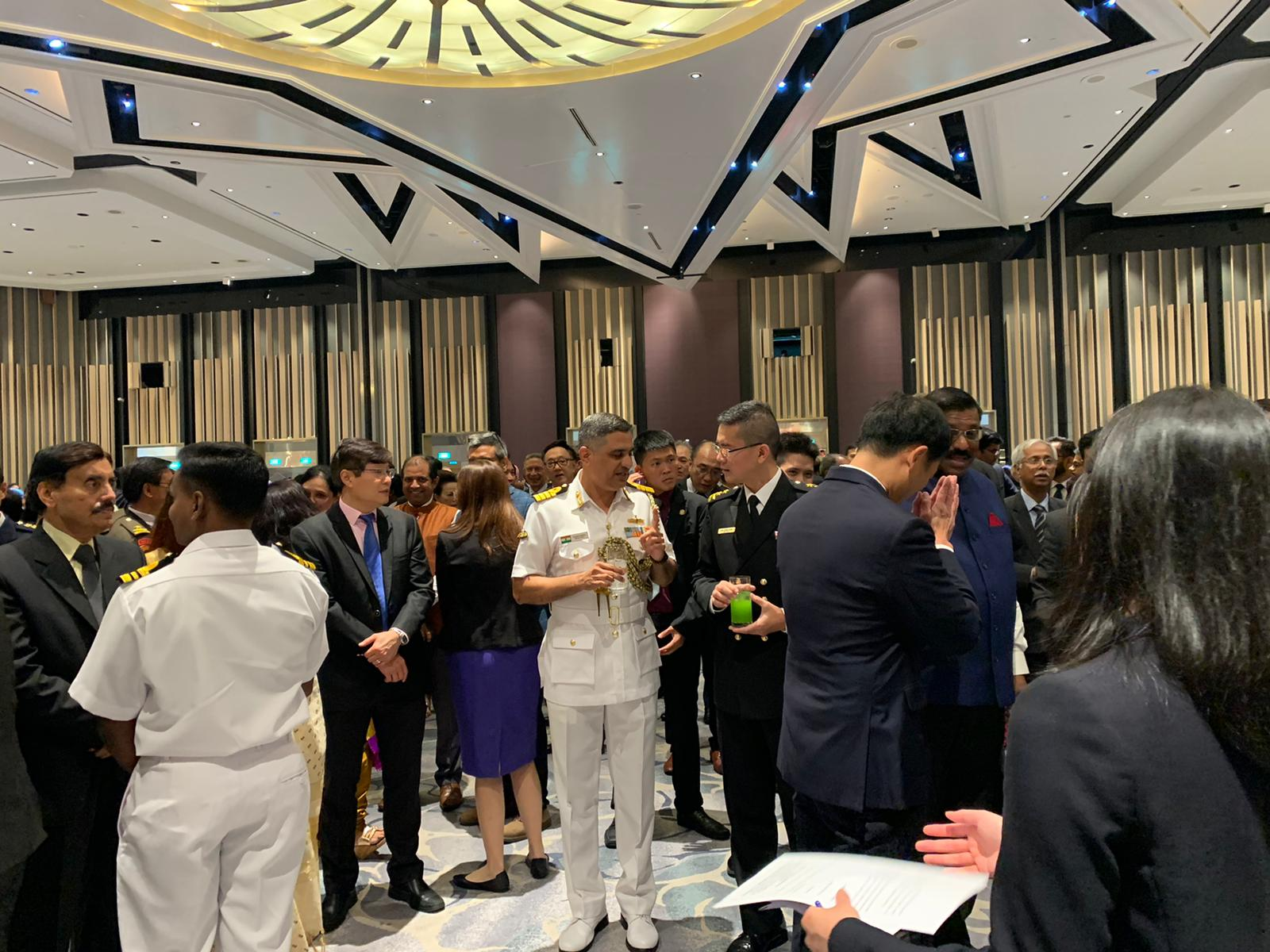 Rear-Admiral Lew Chuen Hong, Chief of Navy of the Republic of Singapore in conversations with senior members of the Republic of India Navy at the reception to celebrate India's 71st Republic Day in Singapore. Photo: Connected to India