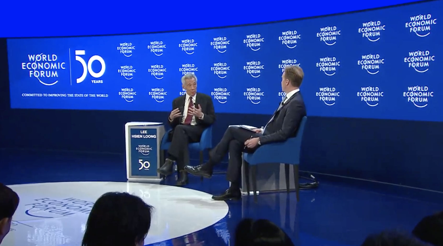 PM Lee Hsien Loong speaking at one of the dialogue sessions at World Economic Forum (WEF). Photo courtesy: Screenshot from WEF video