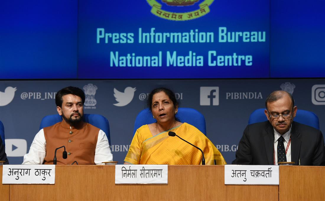 The Union Minister for Finance and Corporate Affairs Nirmala Sitharaman (centre) addressing a Post Budget Press Conference in New Delhi. The Minister of State for Finance and Corporate Affairs, Anurag Singh Thakur (left) and Atanu Chakraborty, the Revenue Secretary are also seen. Photo courtesy: PIB