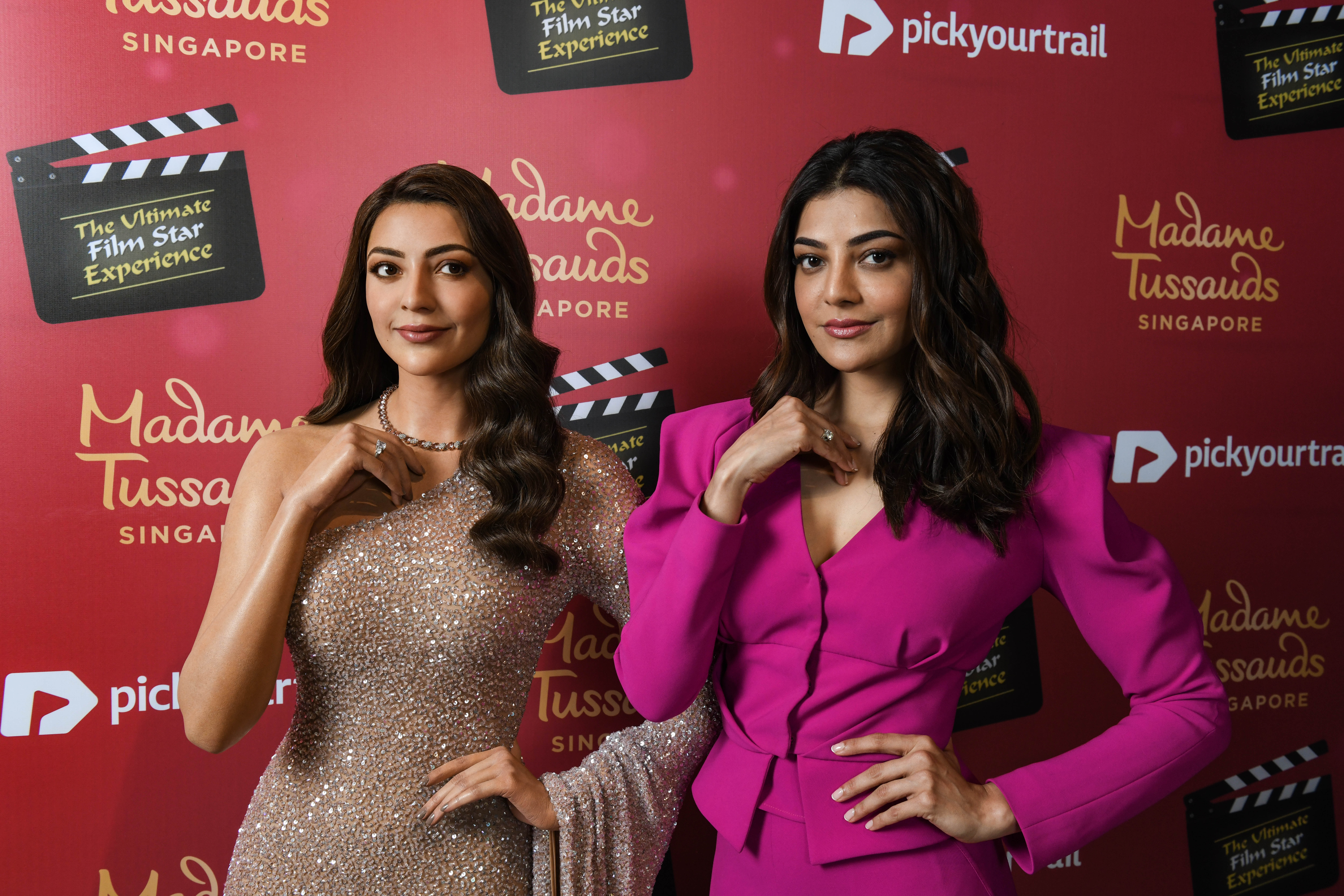 """It feels like I'm seeing myself through the eyes of an artist, the resemblance is uncanny and the attention to detail is spectacular,"""" said Kajal Aggarwal while posing side-by-side  with her newly unveiled wax figure at Madame Tussauds Singapore. Photo Courtesy: Madame Tussauds Singapore"""