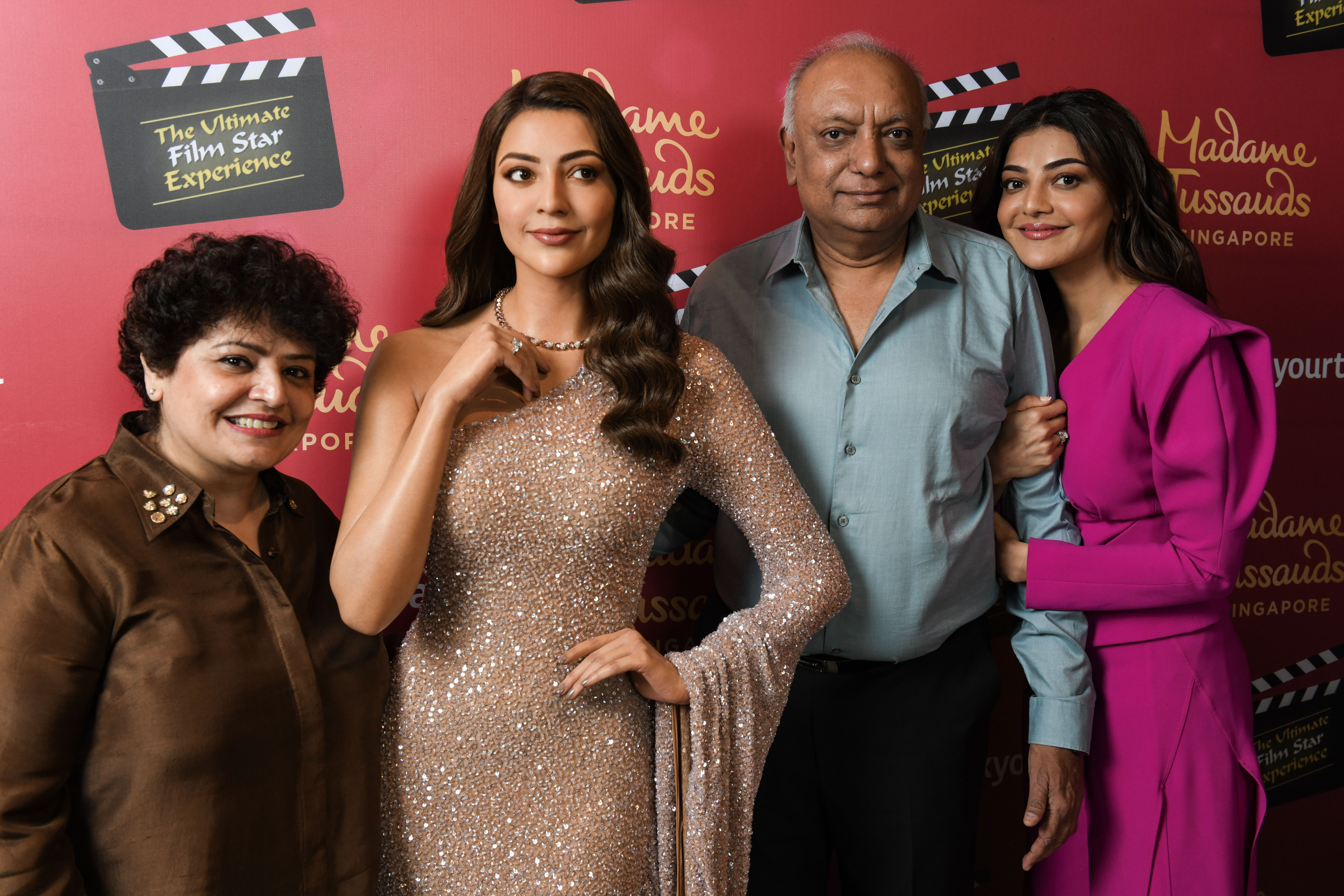 Kajal Aggarwal's dad had tears in his eyes as he and her mom posed with her newly unveiled wax figure at Madame Tussauds Singapore. Photo Courtesy: Madame Tussauds Singapore
