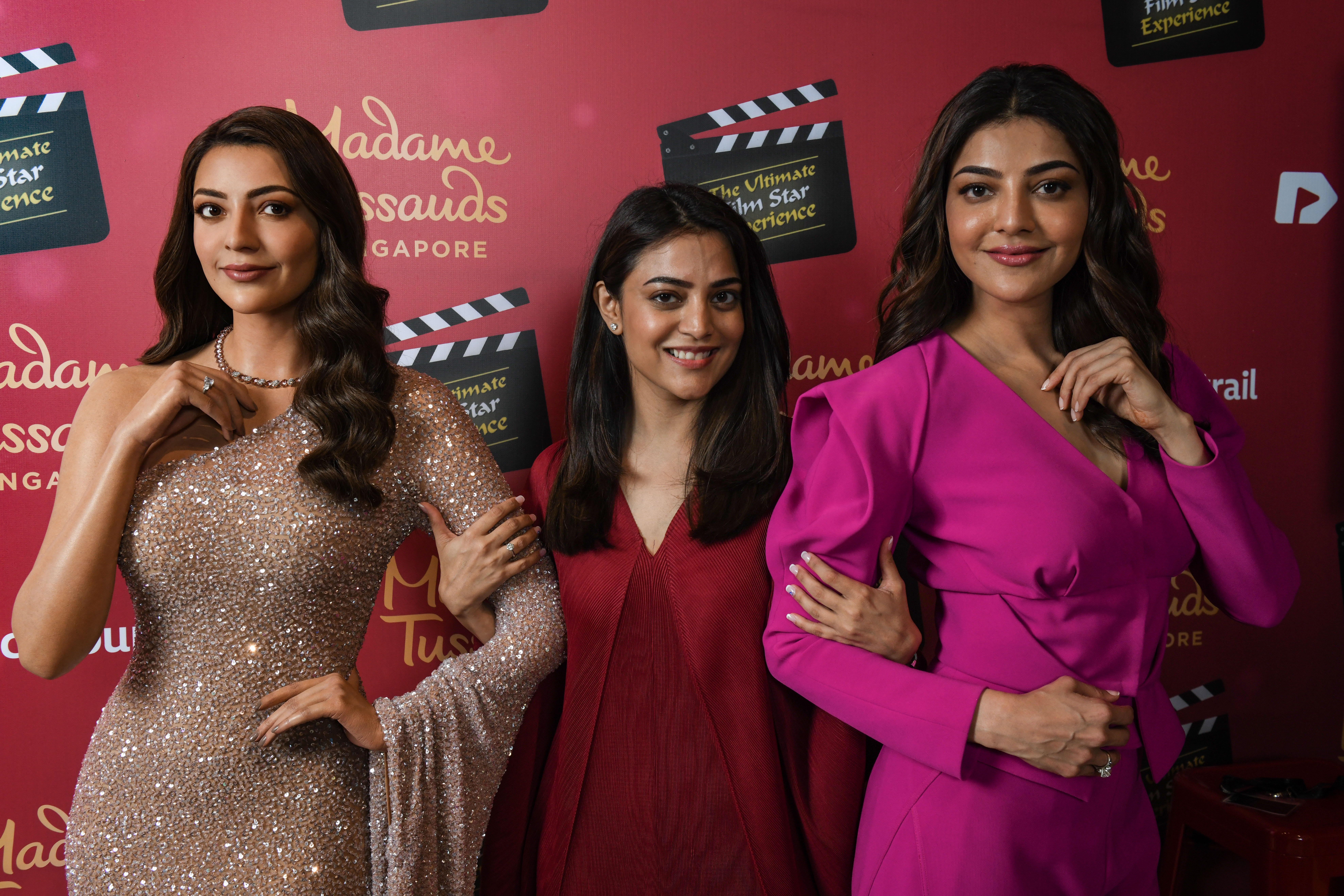 Nisha Aggarwal, Kajal Aggarwal's pretty sister who has herself acted in Tamil, Telugu andMalayalam films, posing with Kajal and her wax figure at Madame Tussauds Singapore Photo Courtesy: Madame Tussauds Singapore