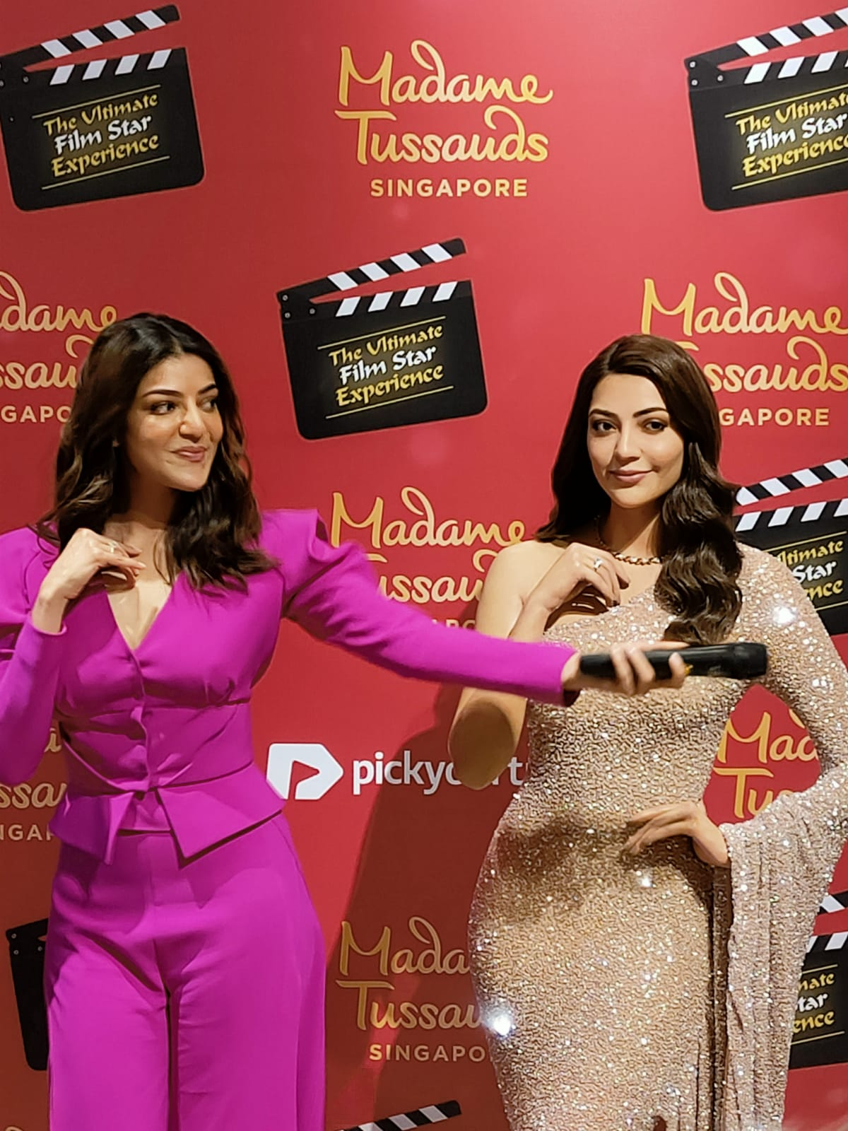 The bubbly Kajal Aggarwal interacted enthusiastically with the media and fans and even spoke a few words in Tamil, at the unveiling of her wax statue at Madame Tussaud's Singapore which was attended by her family and friends who had specially flown in for the occassion. Photo: Connected to India