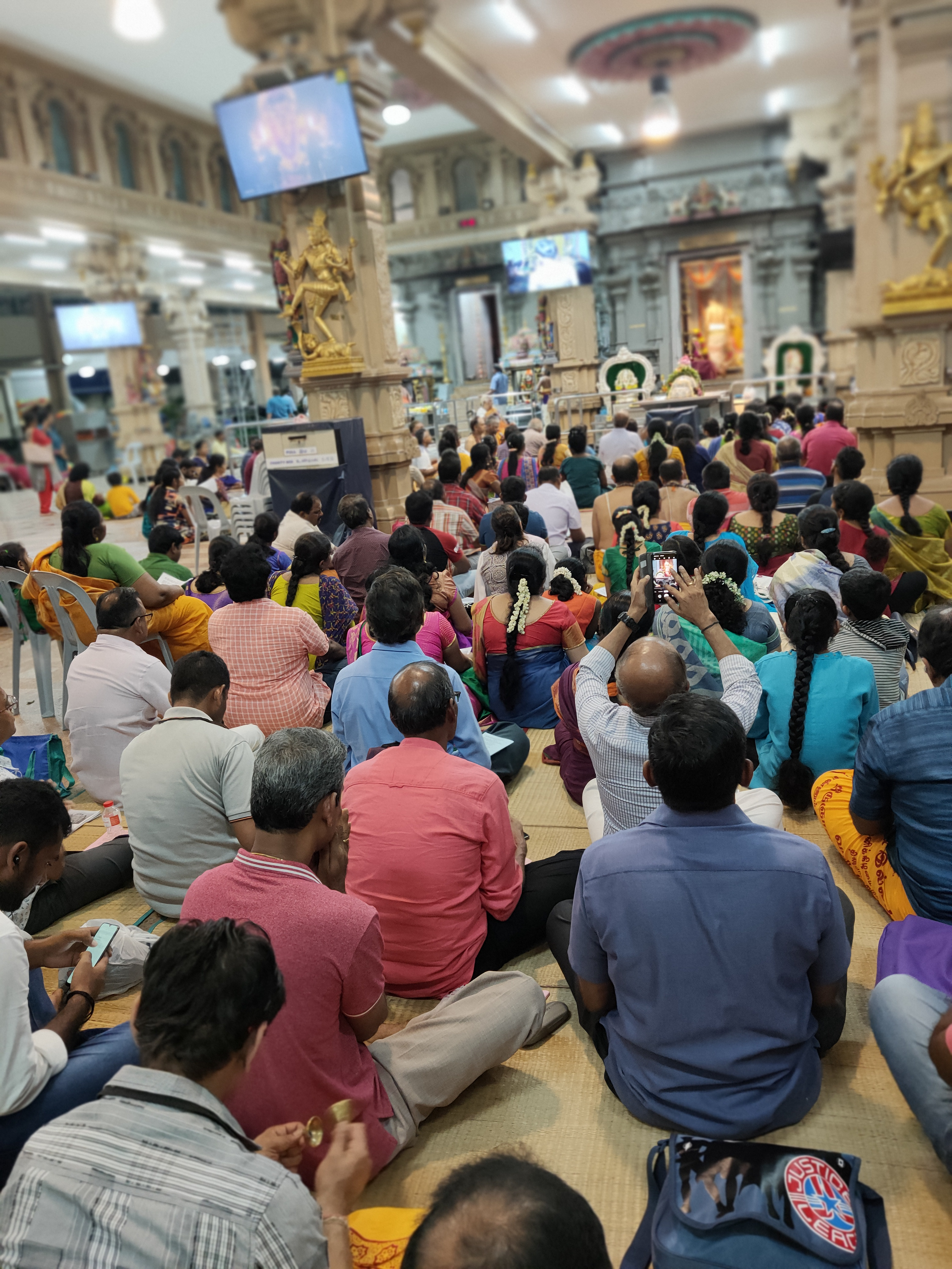 Devotees sit and chant in unison as they watch the prayers being offered to Lord Shiva. Photo:Connected to India