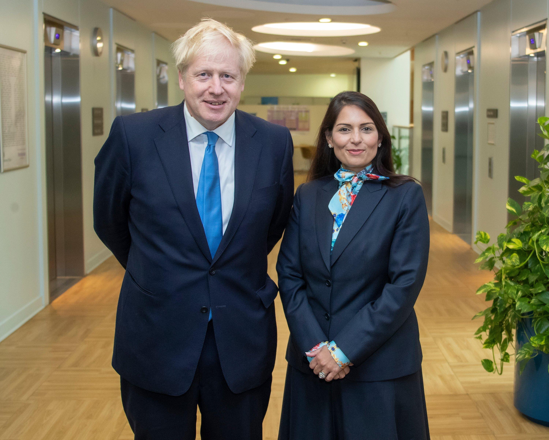 UK Prime Minister Boris Johnson with Indian-origin Home Minister Priti Patel. File photo courtesy: Twitter/@10DowningStreet