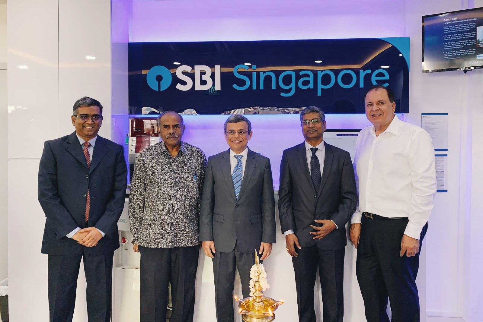 (from left) P. Jamneshwar, Chief Executive Officer, SBI Singapore; Ambassador K Kesavapany; High Commissioner of India to Singapore Jawed Ashraf; Kishore Kumar Poludasu, Country Head of SBI Singapore; and Narandas Gangaram, Radha Exports, at the launch of State Bank of India (SBI) Singapore's new Jurong East branch. Photo: Connected to India