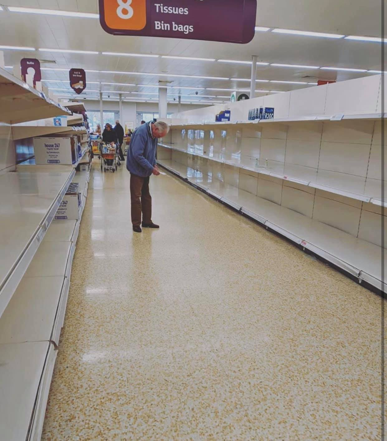 Panic buying in the UK leaves grocery store shelves empty, prompting supermarket chains to impose purchase limits. Photo courtesy: Twitter/@Covid19depot