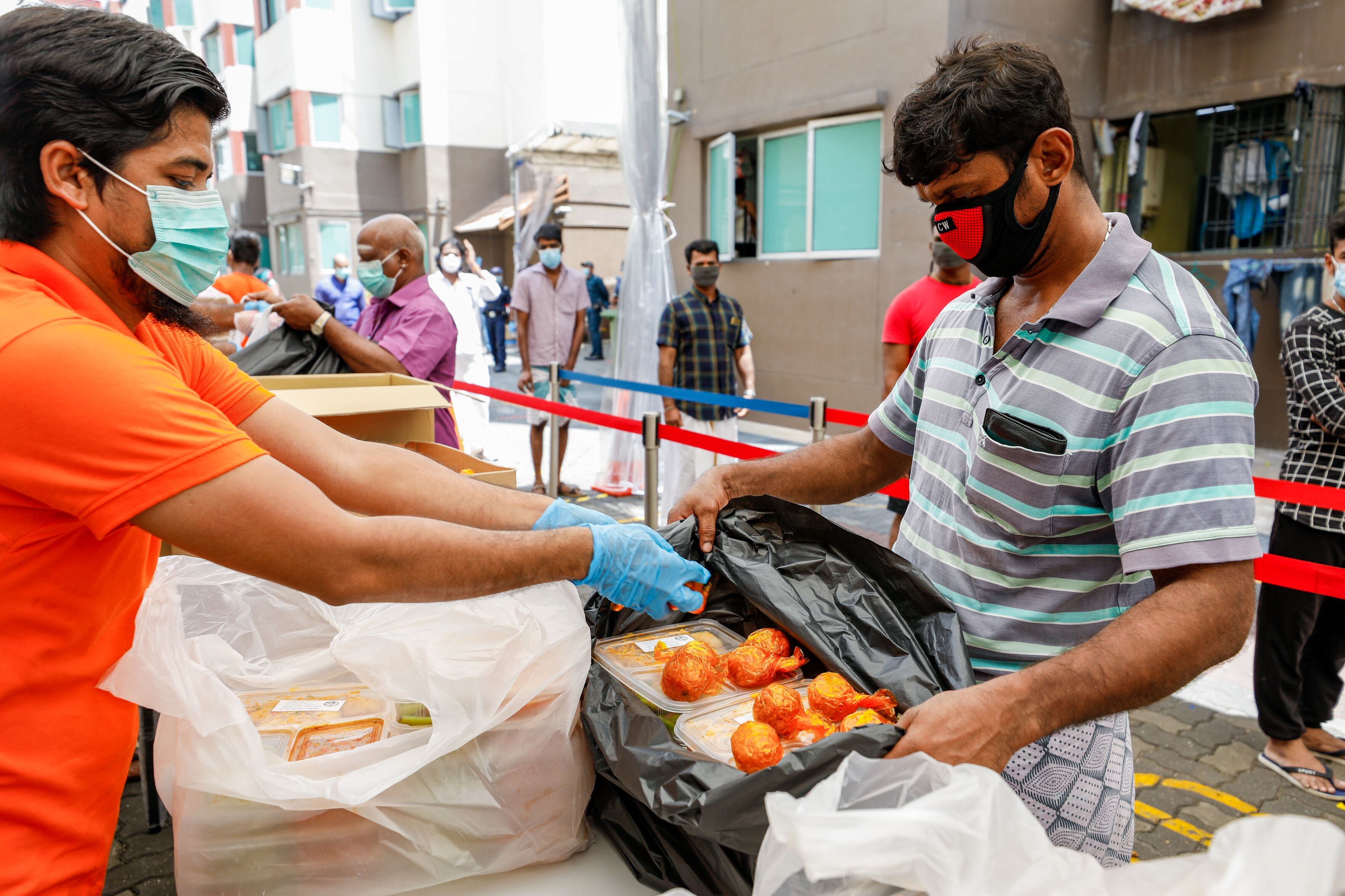 Workers at Westlite Toh Guan collecting sweets during lunch. Photo courtesy: Ministry of Manpower (MOM)