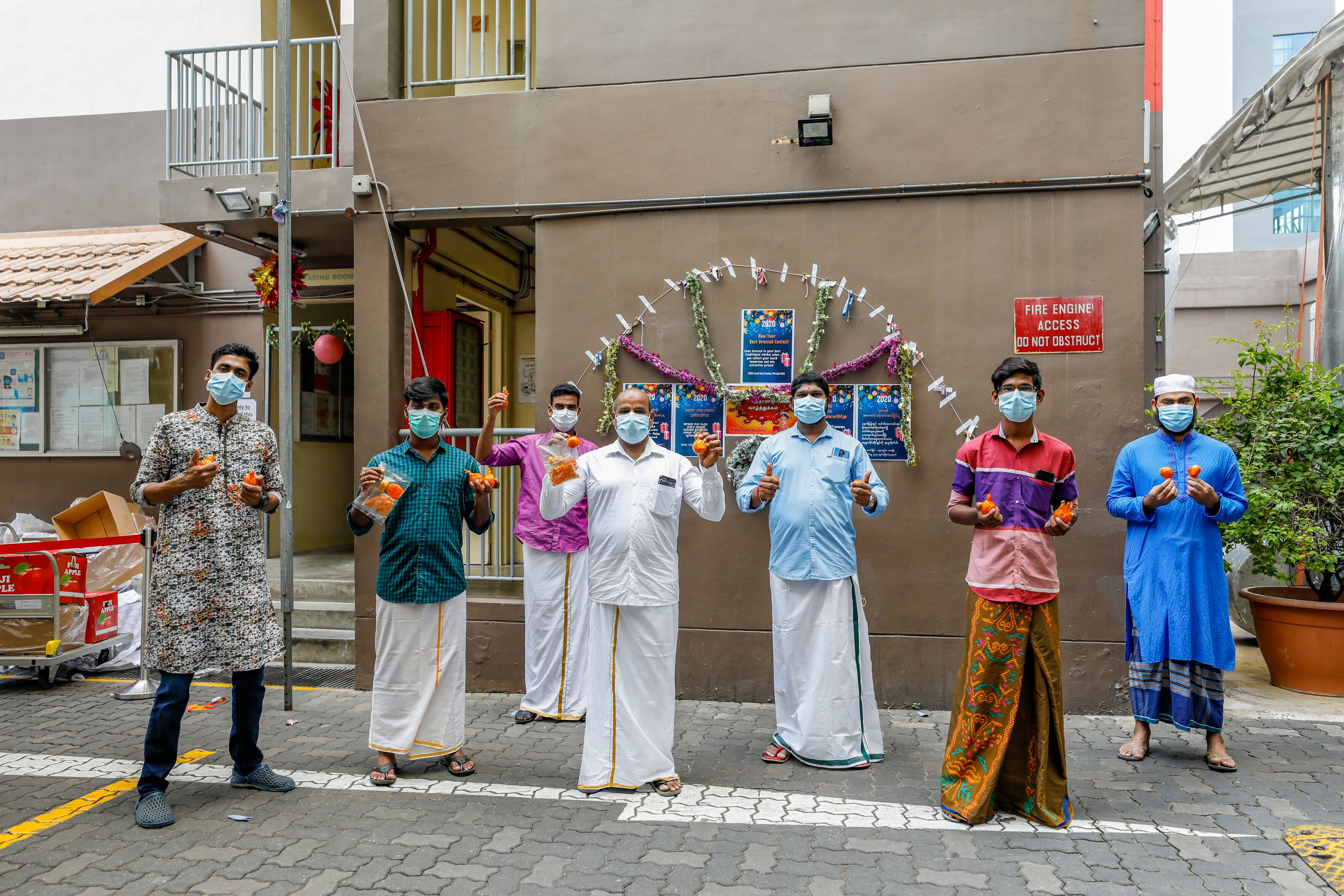 Workers dressed up for Bengali New Year. Photo courtesy: Ministry of Manpower (MOM)