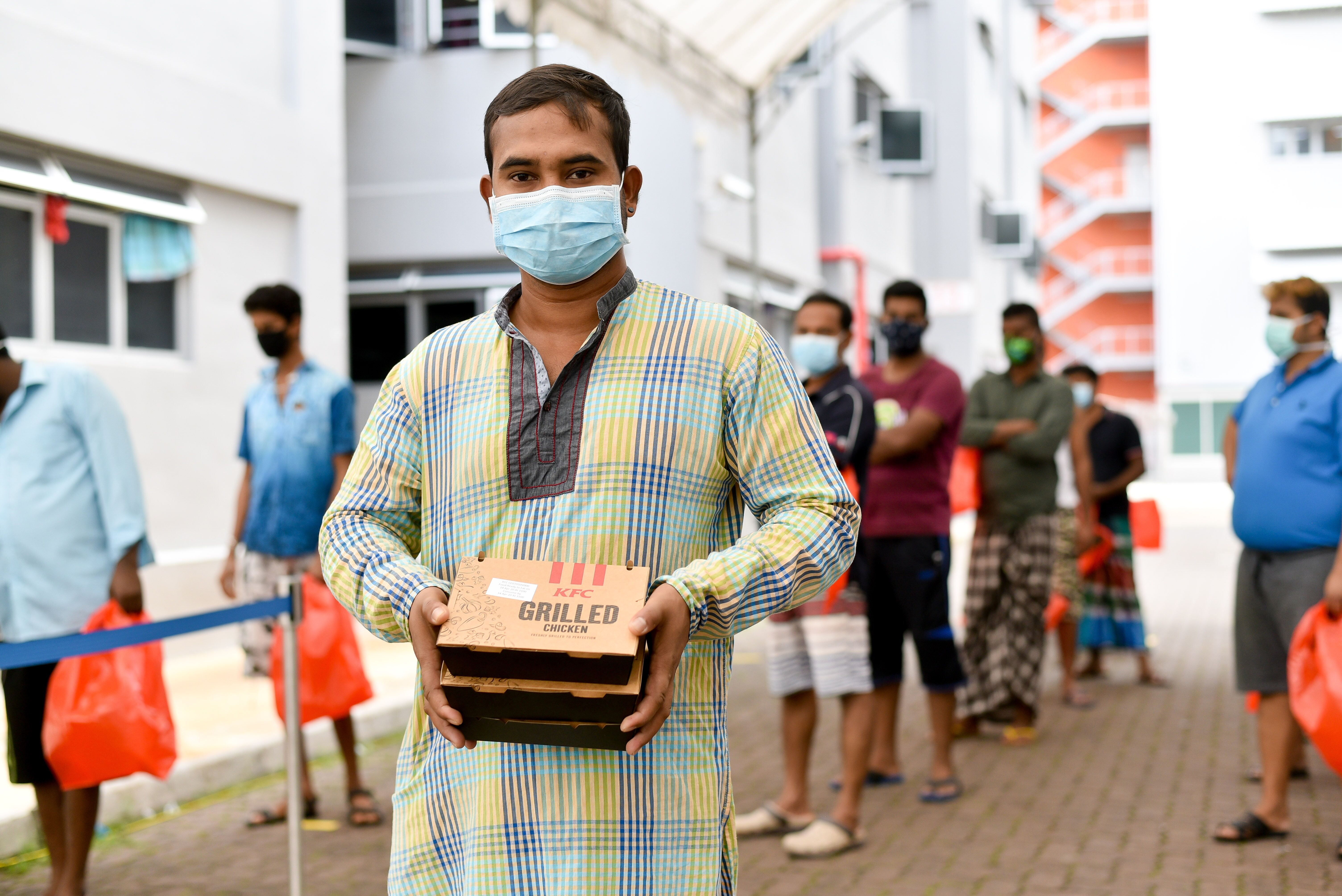 The workers also received fast food treats to celebrate the occasion. Photo courtesy: Ministry of Manpower (MOM)
