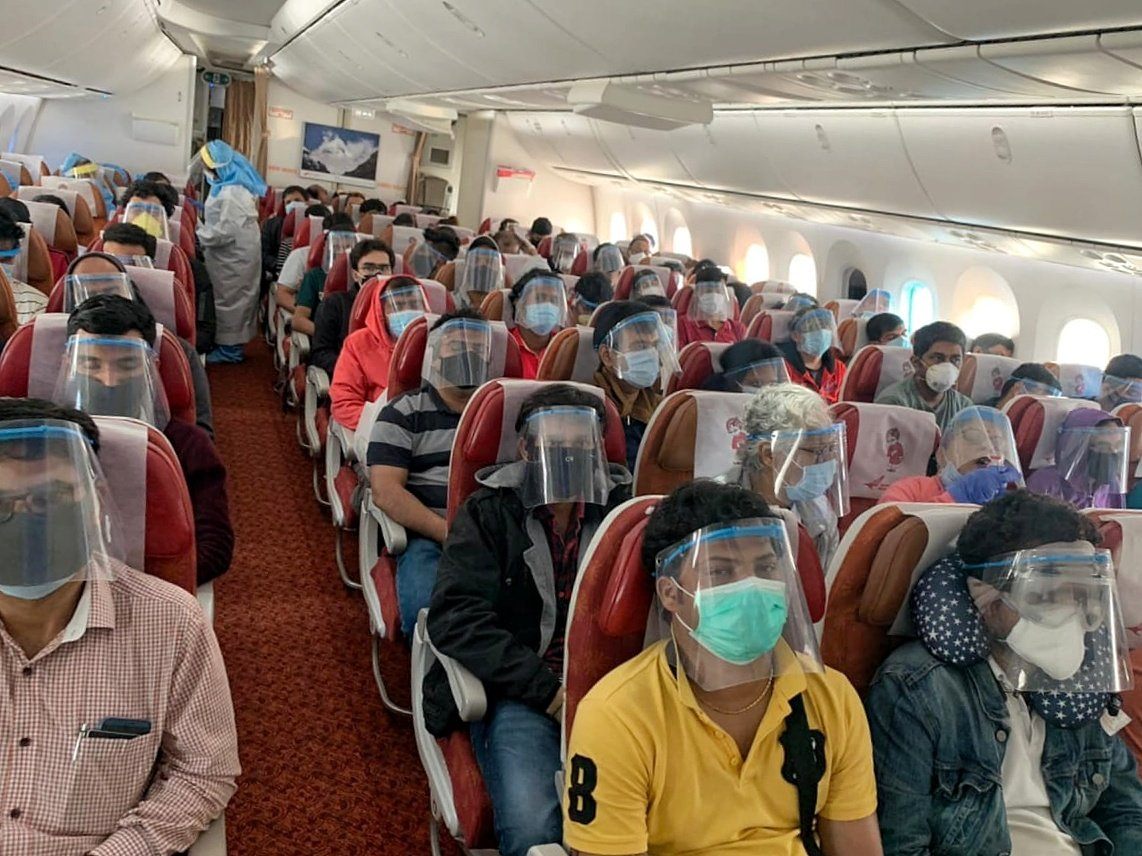 Passengers provided with masks and face shields on repatriation flights. Photo courtesy: Twitter/@HardeepSPuri