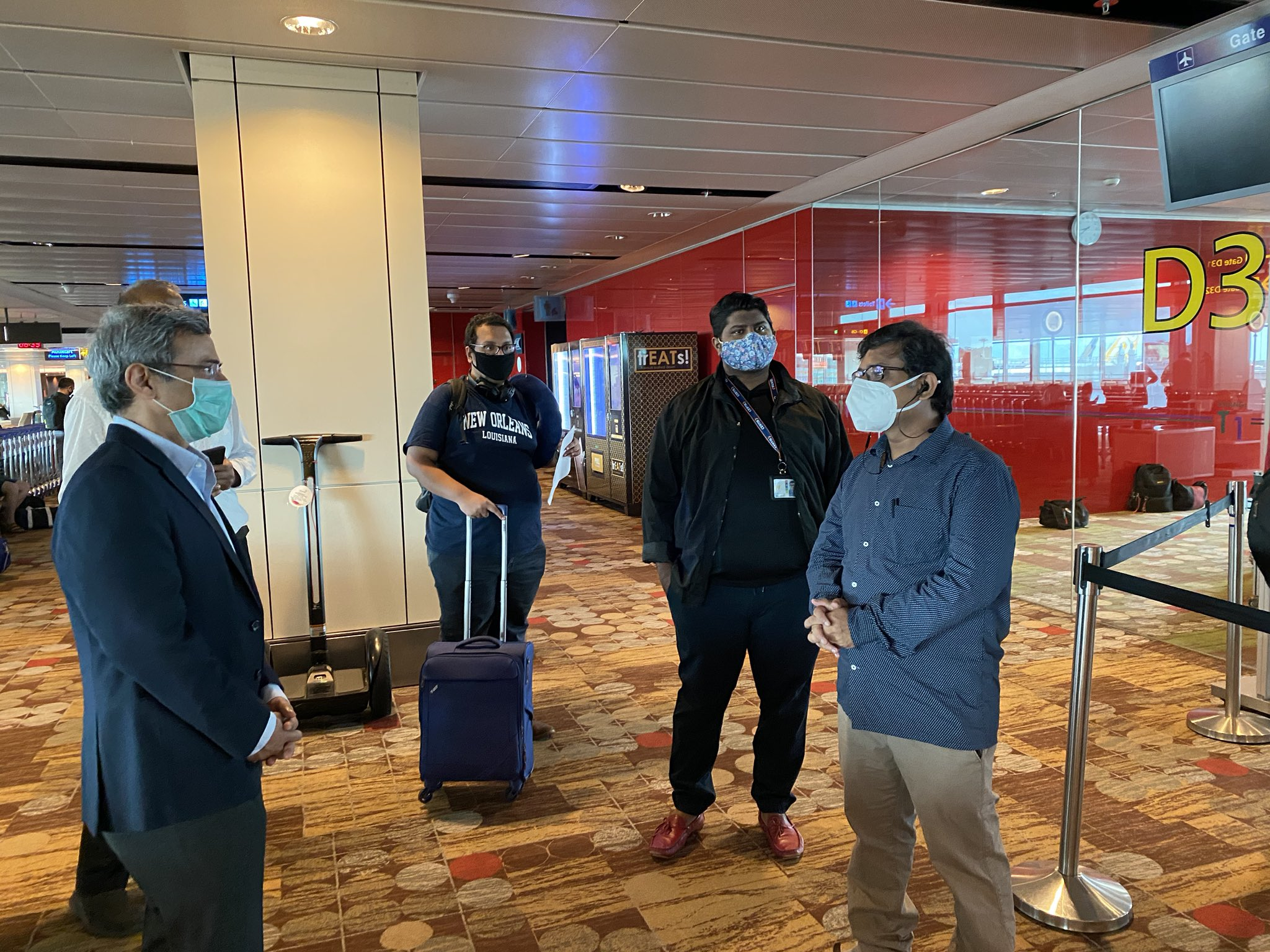 Indian High Commissioner to Singapore Jawed Ashraf interacting with passengers being repatriated to India. Photo courtesy: Twitter/@IndiainSingapor