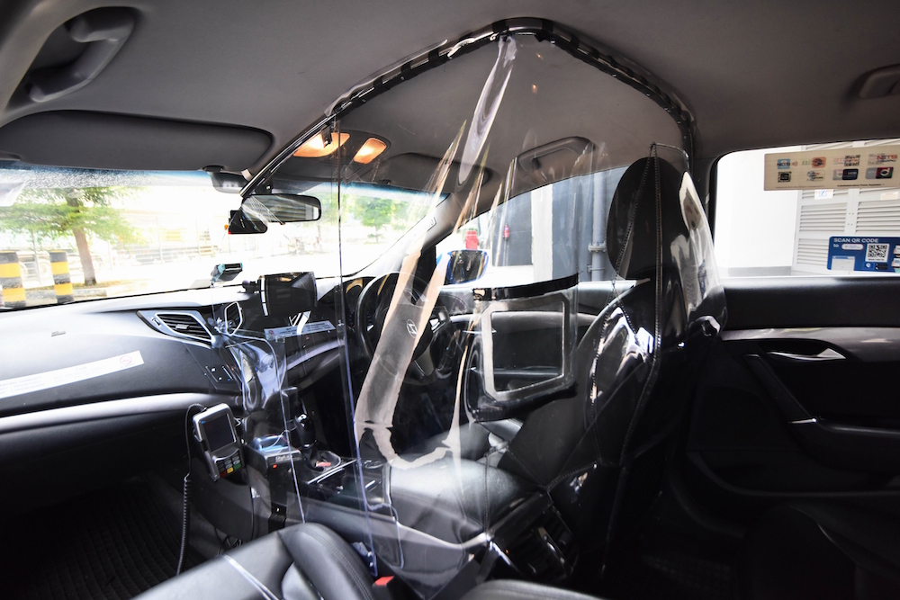 "Called V-shield, the shield has two ""window"" openings for passengers to make payment. Photo courtesy: ComfortDelGro"