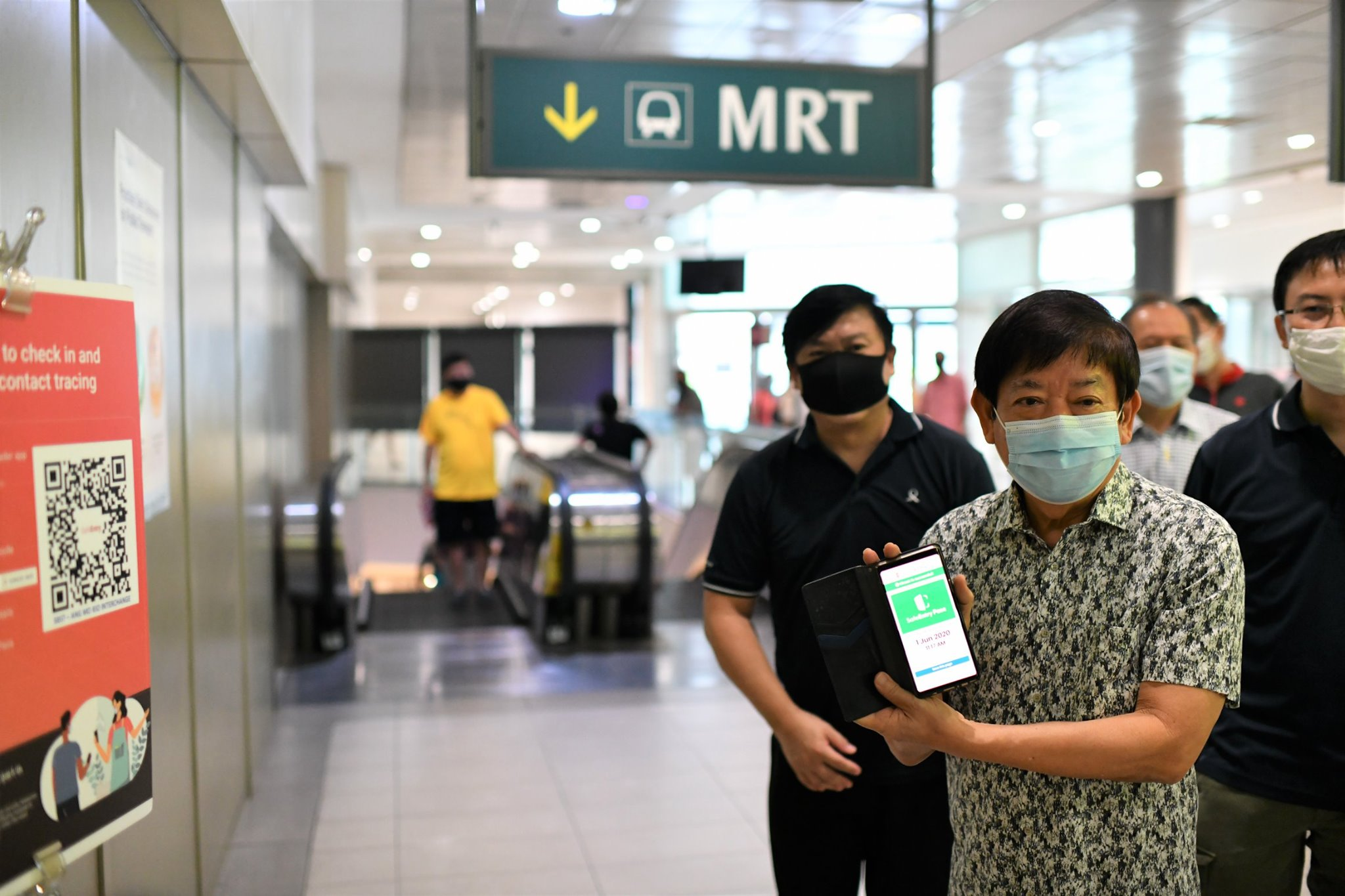 Checking in and out of places using SafeEntry is part of the new normal, said Minister Khaw Boon Wan. Photo courtesy: Facebook: Khaw Boon Wan