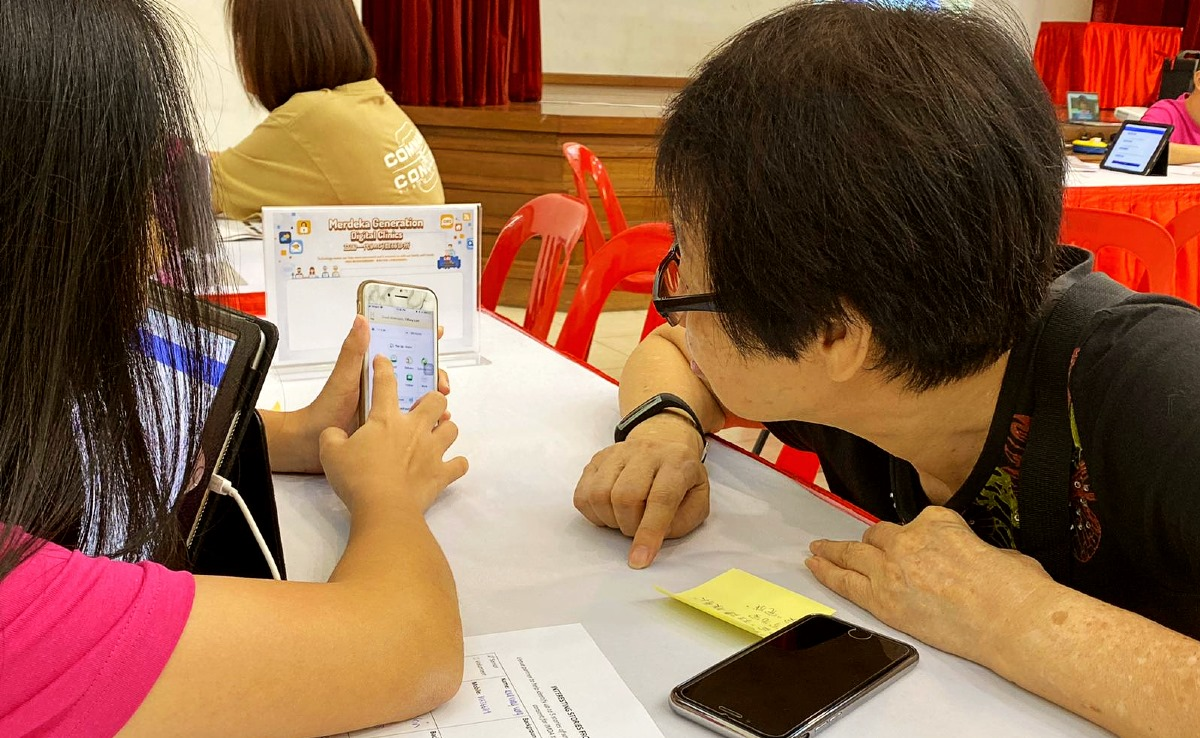 IMDA's community of Digital Ambassadors will be reaching out to engage the seniors. Photo courtesy: IMDA