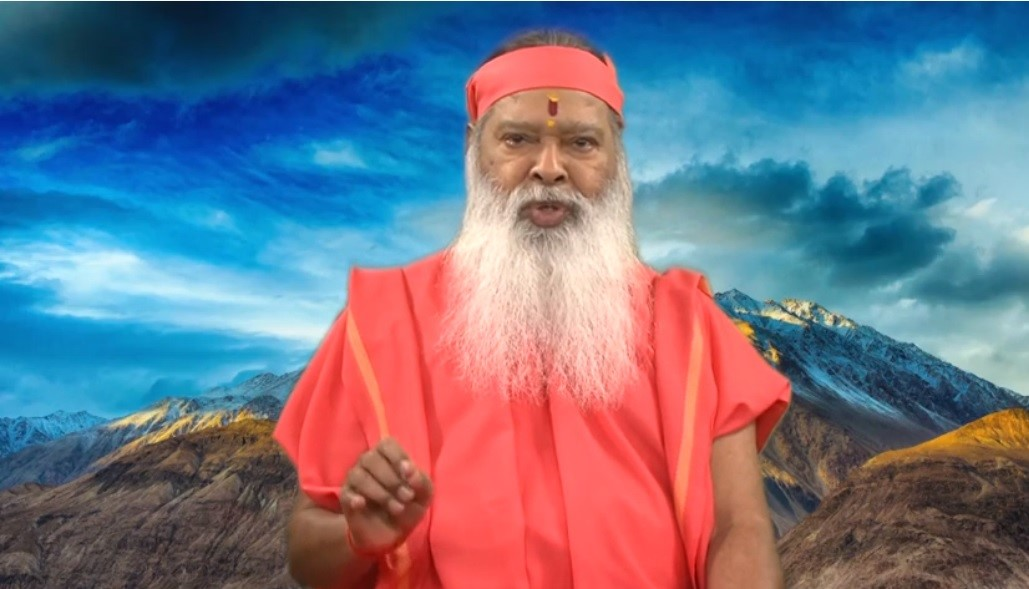 Indian spiritual guru, Sri Ganapathi Sachidananda Swamiji, wrote the lyrics and also recites them at the beginning of this musical video. Photo Courtesy: Screenshot of video