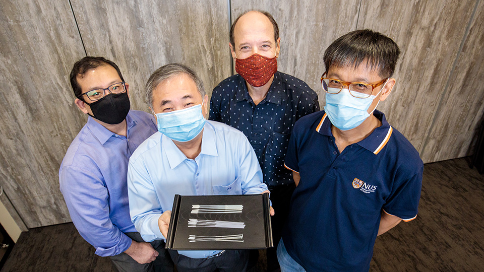 Professor Freddy Boey (centre, showing the swabs), and (from left) Dr Alfred Chia, Associate Professor David Allen, and Associate Professor Yen Ching-Chiuan are part of two NUS teams that developed three nasopharyngeal swab designs for COVID-19 testing. Photo courtesy: NUS