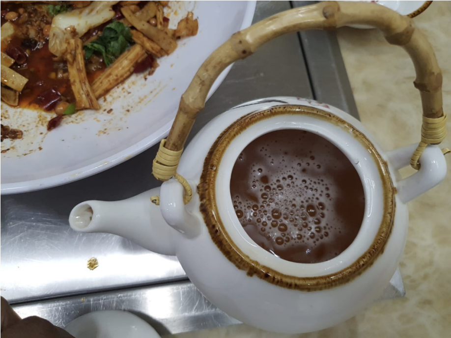 Sale and consumption of alcoholic beverages was observed after 10.30pm at S-Tripes Hotpot, with the beverages transferred into teapots and empty green tea bottles before being served to avoid detection. Photo courtedy: SFA