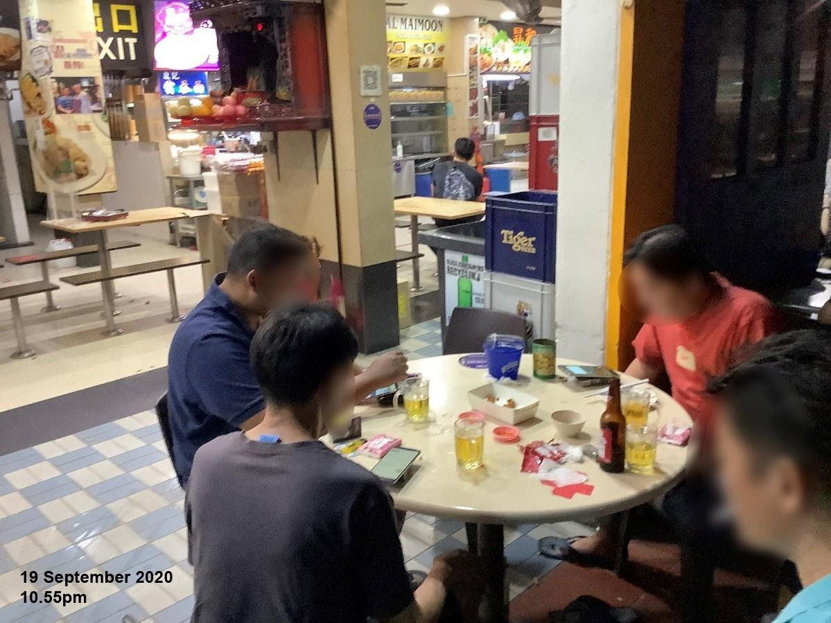 On 19 September 2020, officers observed patrons consuming alcohol at 10.55pm at two tables in the outdoor refreshment area at Blk 261, Serangoon Central Drive. Photo courtesy: Singapore Food Agency