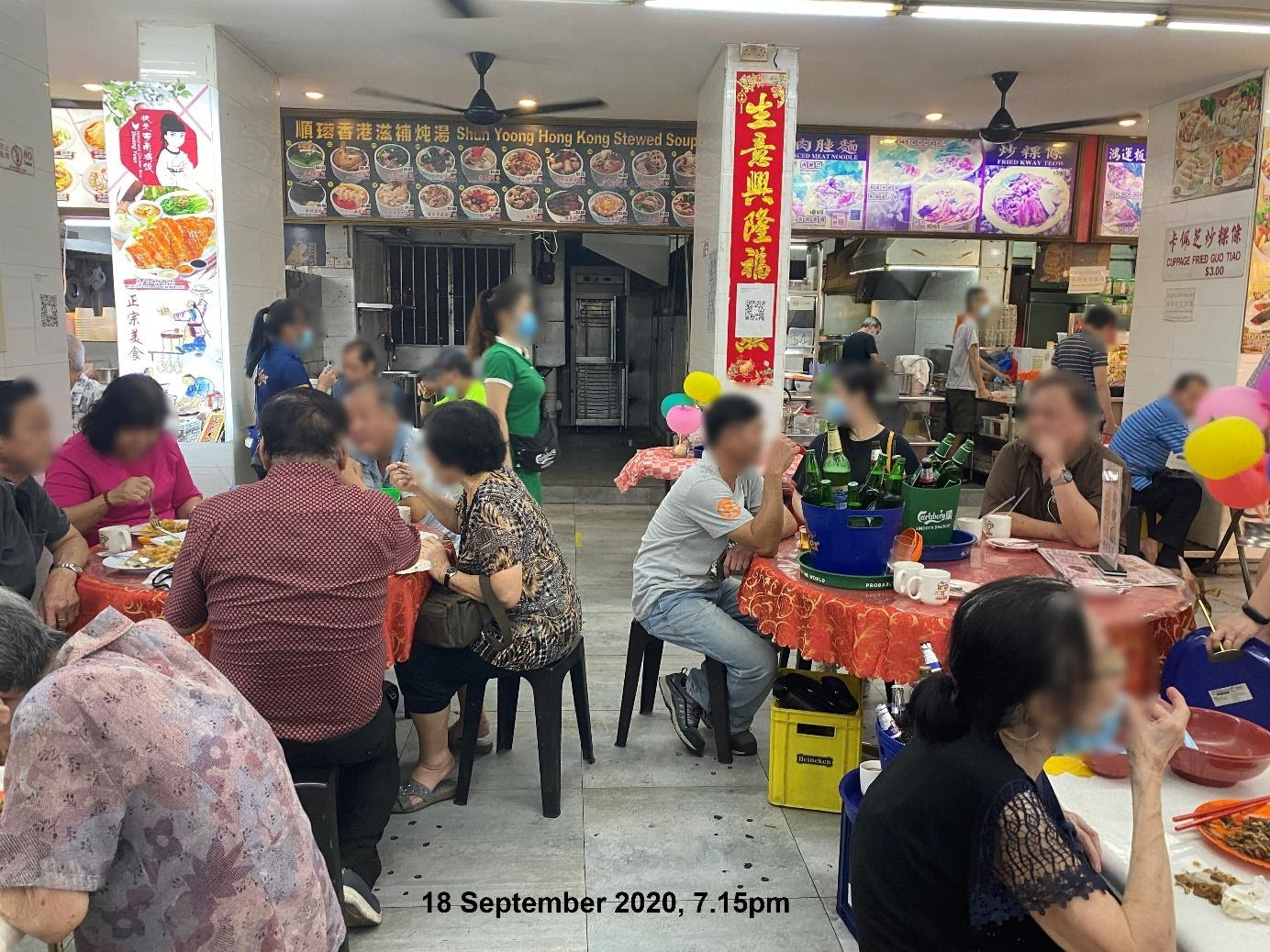 Patrons at two different tables in an F&B outlet in Chinatown were seated less than 1 metre apart. Photo courtesy: Singapore Food Agency