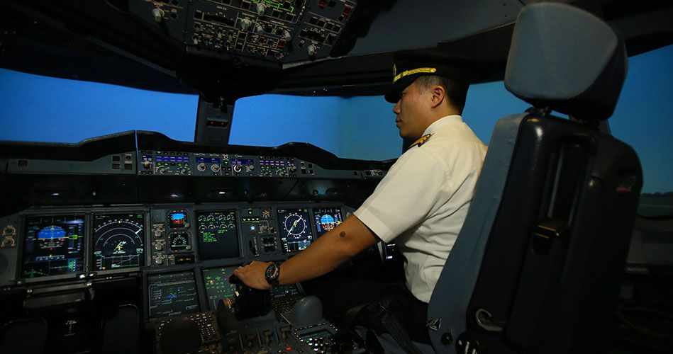 Visitors can try operating a flight simulator! Photo courtesy: SIA