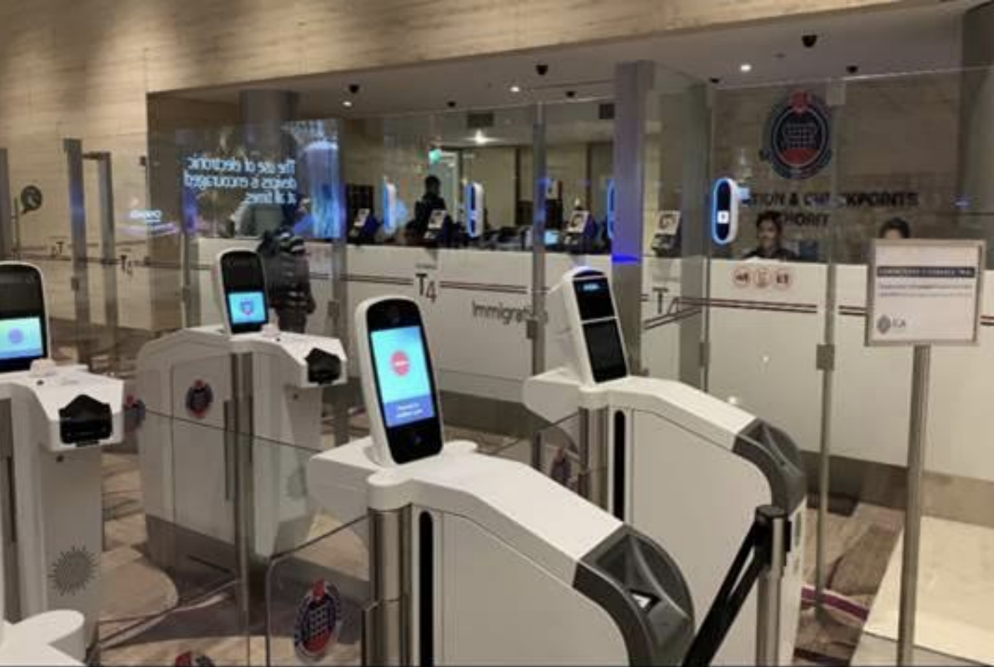 Automated immigration lanes with iris and facial scanning at Changi Airport Terminal 4. Photo courtesy: ICA