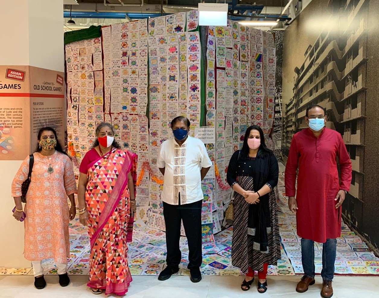 Mr and Mrs Vijaya Mohan (centre) with the management committee members of the Singapore Malayalaee Association whose members coloured 6000 of the cards.  Photo Courtesy: SingaRangoli