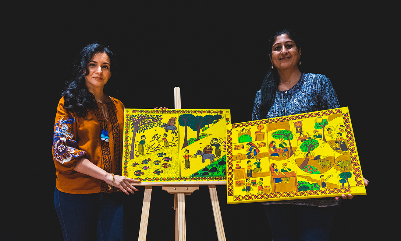 Kamini (left) with Kumuda (right) with the illustrations which were hand-painted on canvas and then filmed separately.