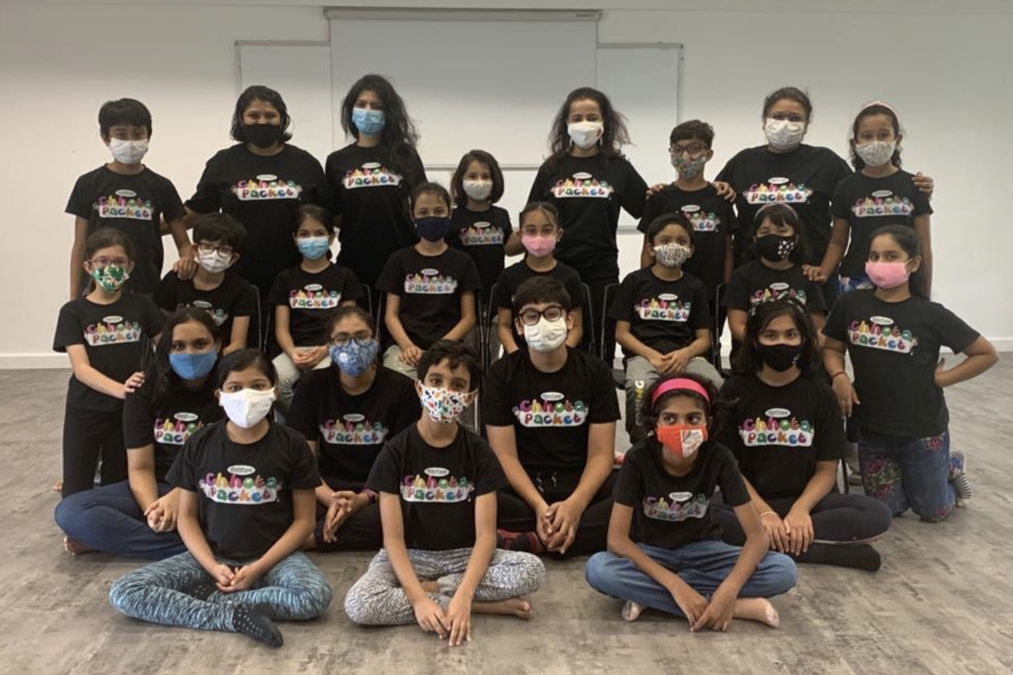 The title Earthward Ho' was suggested by one of the twenty children who attended Dastak's workshop with Shalaka Ranadive (centre top row). Photo Courtesy: Dastak