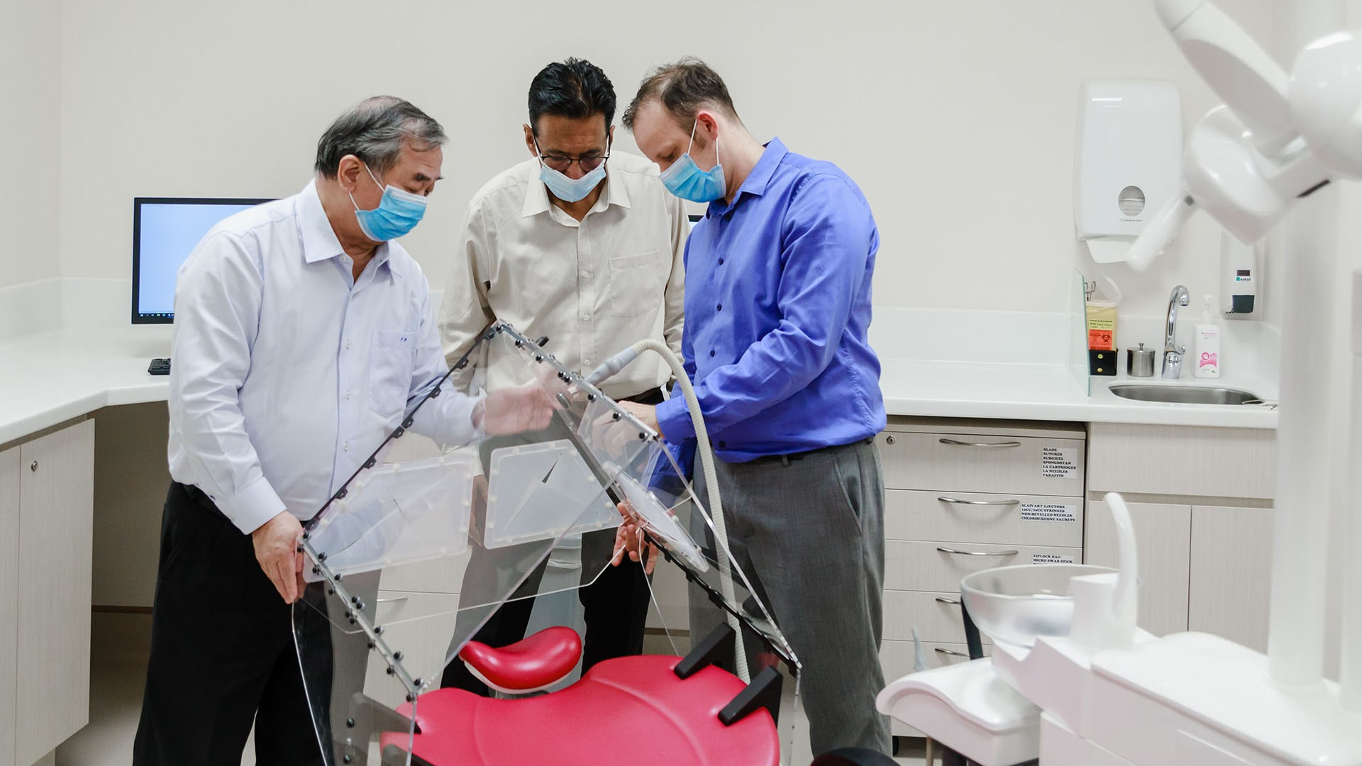 The Dental Droplet and Aerosol Reducing Tent (Dental DART) was developed by NUS researchers (from left) Professor Freddy Boey, Mr Sudarshan Anantharaman, Associate Professor Vinicius Rosa and their team. Photo courtesy: NUS