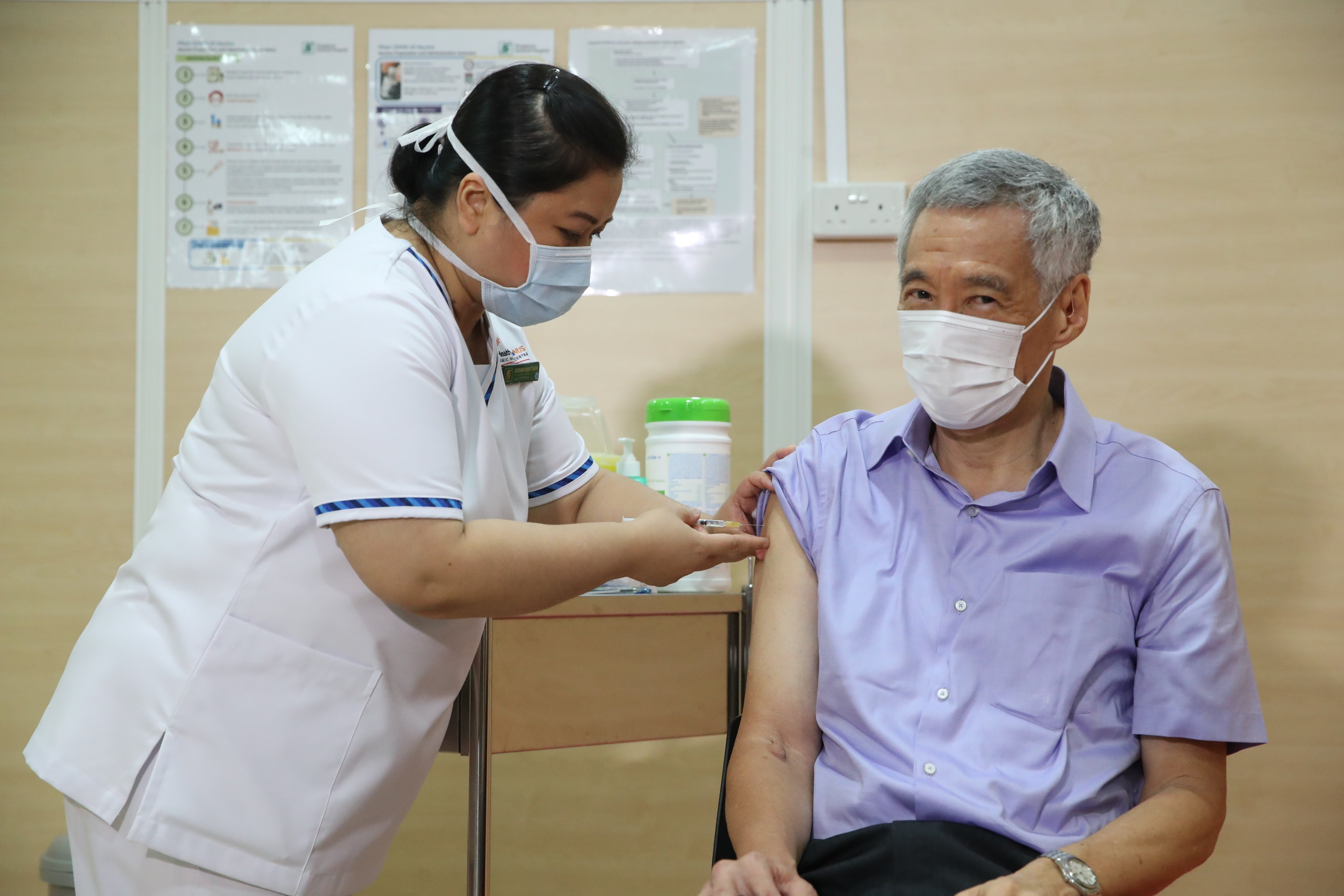 Lee said broader vaccinations of healthcare staff would start now, with the elderly to follow next month, and vaccines to be available to all residents by year end at the latest.