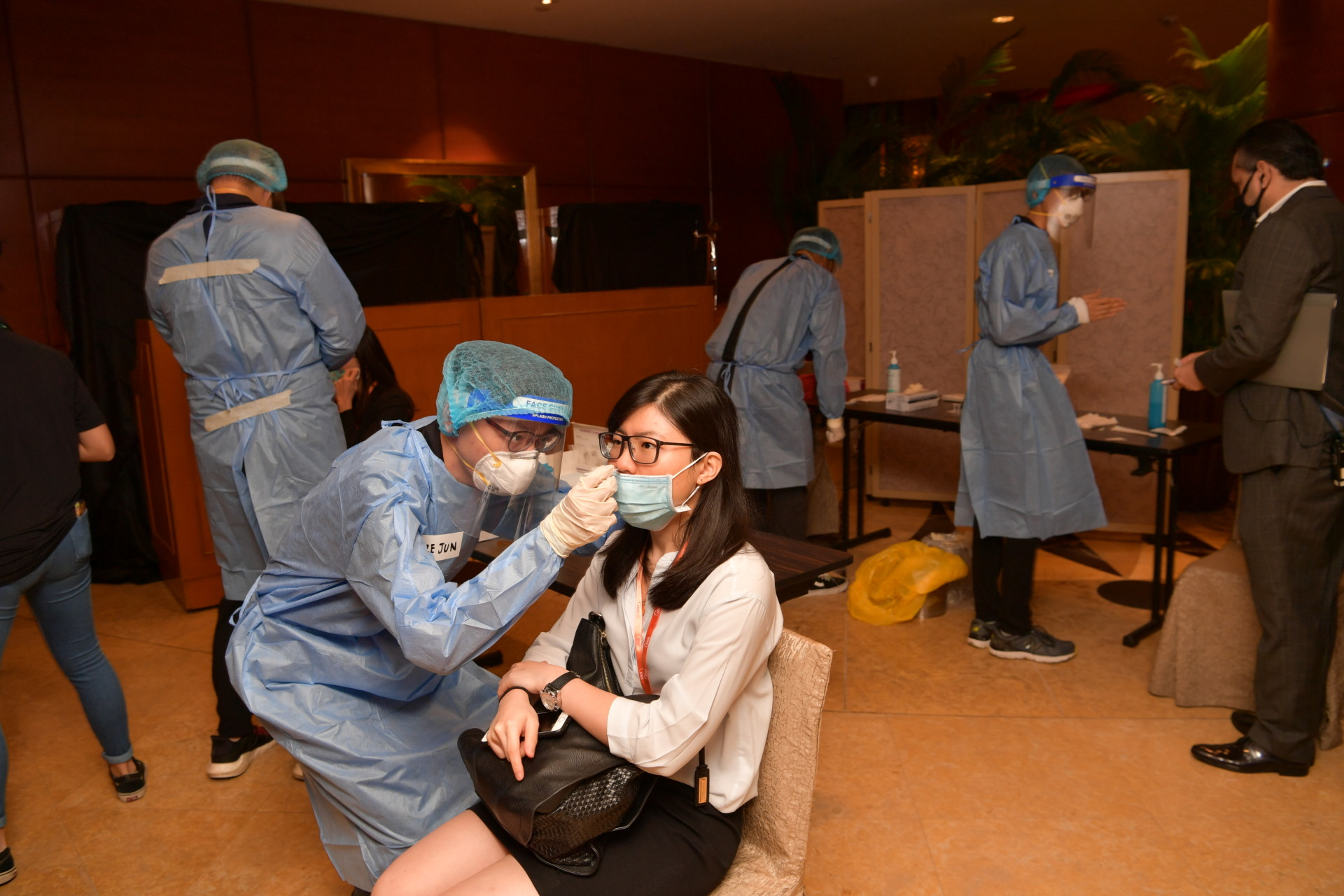Participants of the SLD Sherpa Meeting undergoing pre-entry Antigen Rapid Test to ensure that they are free from infection. Photo Courtesy: MINDEF