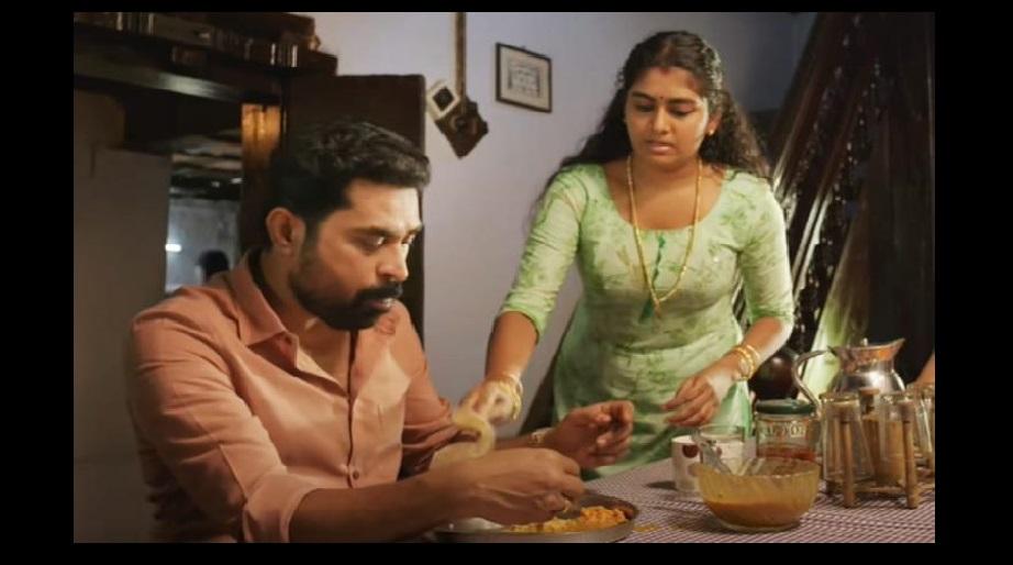 Nimisha Sajayan and Suraj Venjaramoodu star in The Great Indian Kitchen. Photo Courtesy: Screengrab/NeeStream
