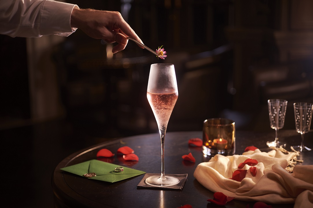 """Femme Fatale, made with Raffles exclusive Champagne Billecart Salmon Brut Reserve NV """"An Iconic Return"""", flowers, apple brandy and Cocchi Rosa. Photo: Raffles Hotel Singapore"""